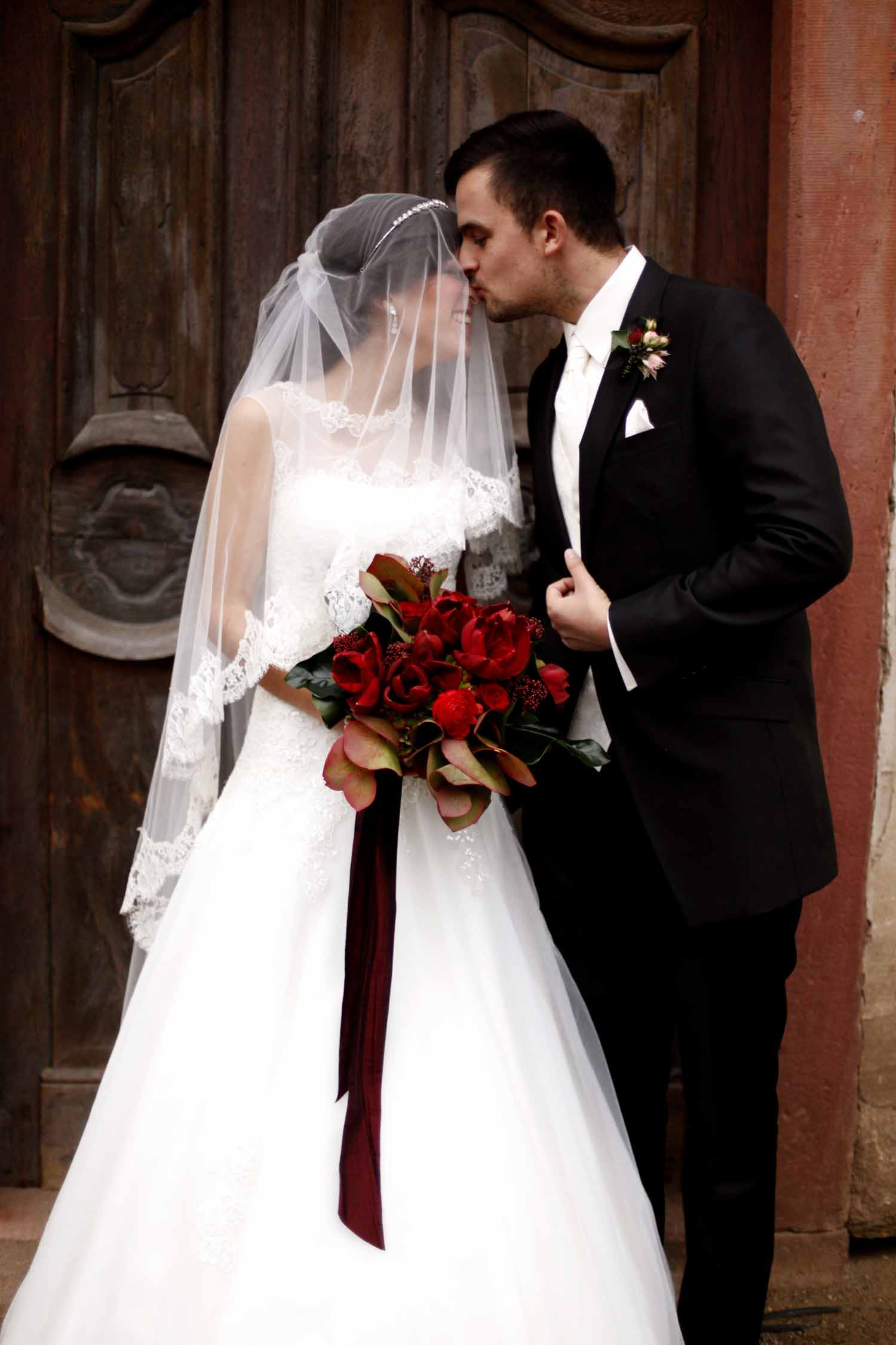 bride with red amaryllis bridal bouquet for Wedding Style Shoot in Kloster Eberbach, Germany, designed by Flora Nova Design, Seattle