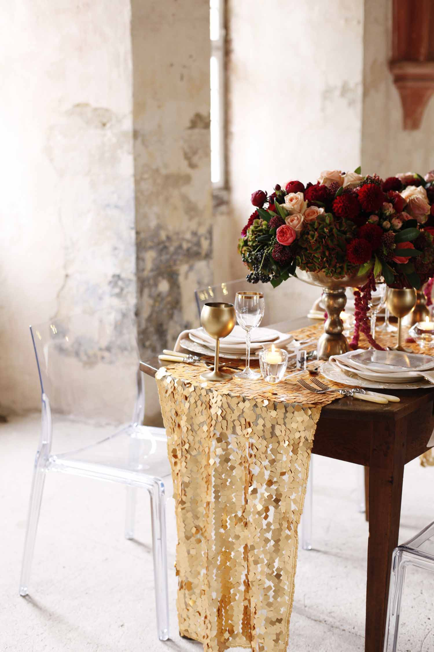 Wooden sweetheart table, gold sequin table runner, and floral centerpiece in gold compote for Wedding Style Shoot in Kloster Eberbach, Germany, designed by Flora Nova Design, Seattle