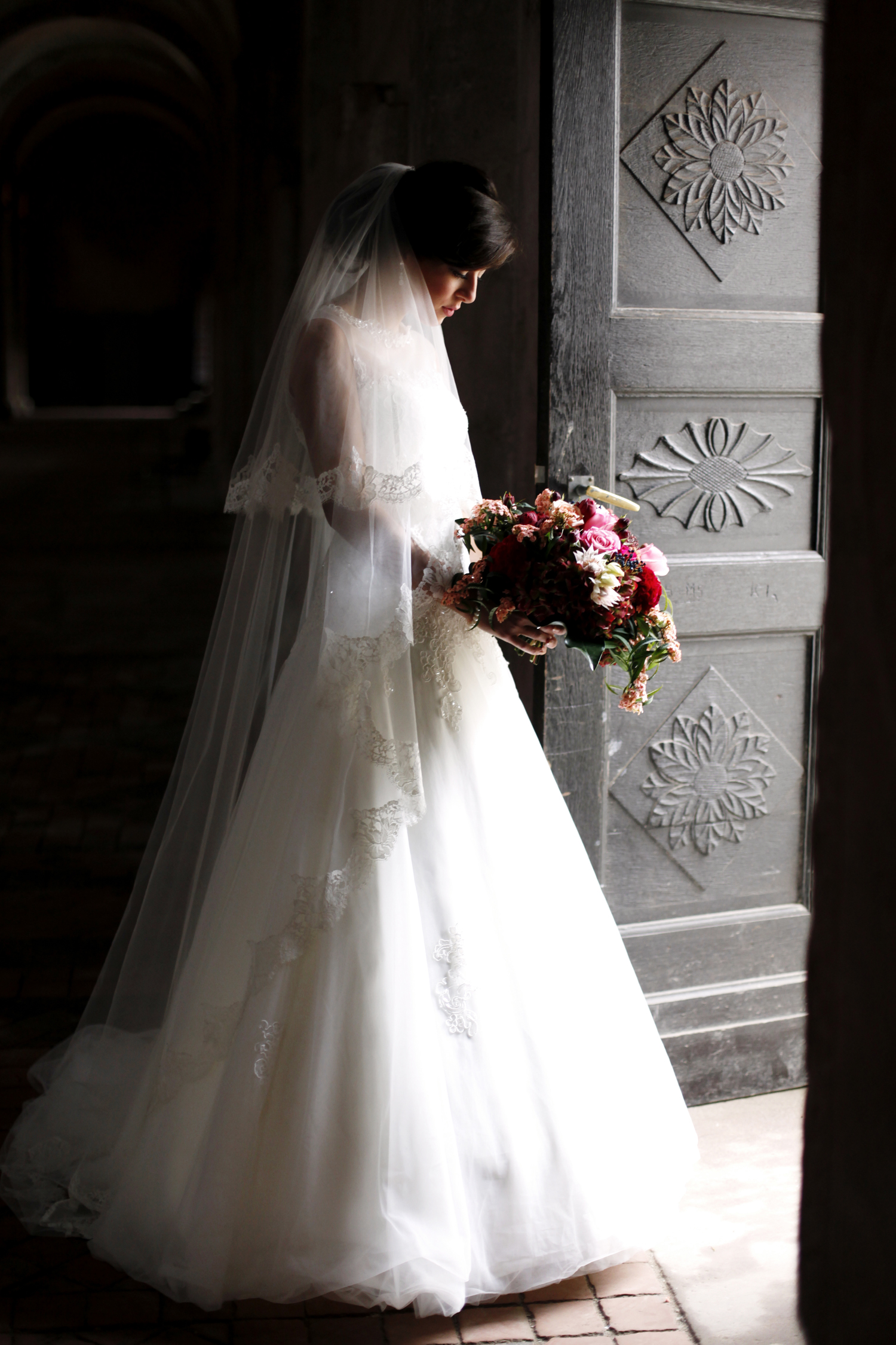 bride and bouquet in front of historic monastery doors for Wedding Style Shoot in Kloster Eberbach, Germany, designed by Flora Nova Design, Seattle