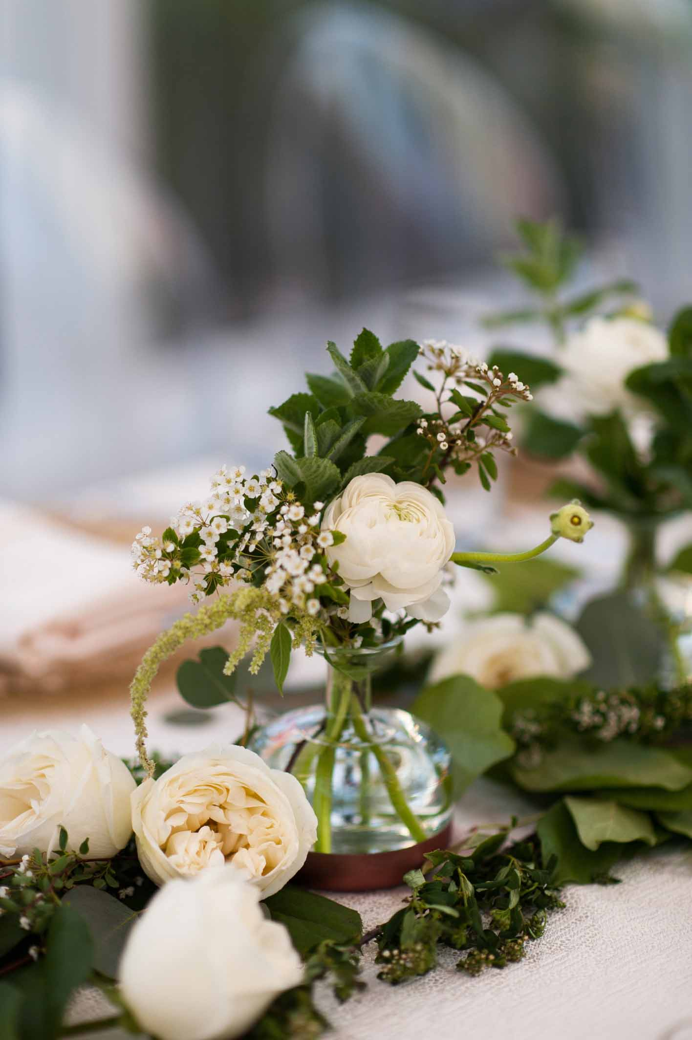 Greenery and white spring flowers on head table