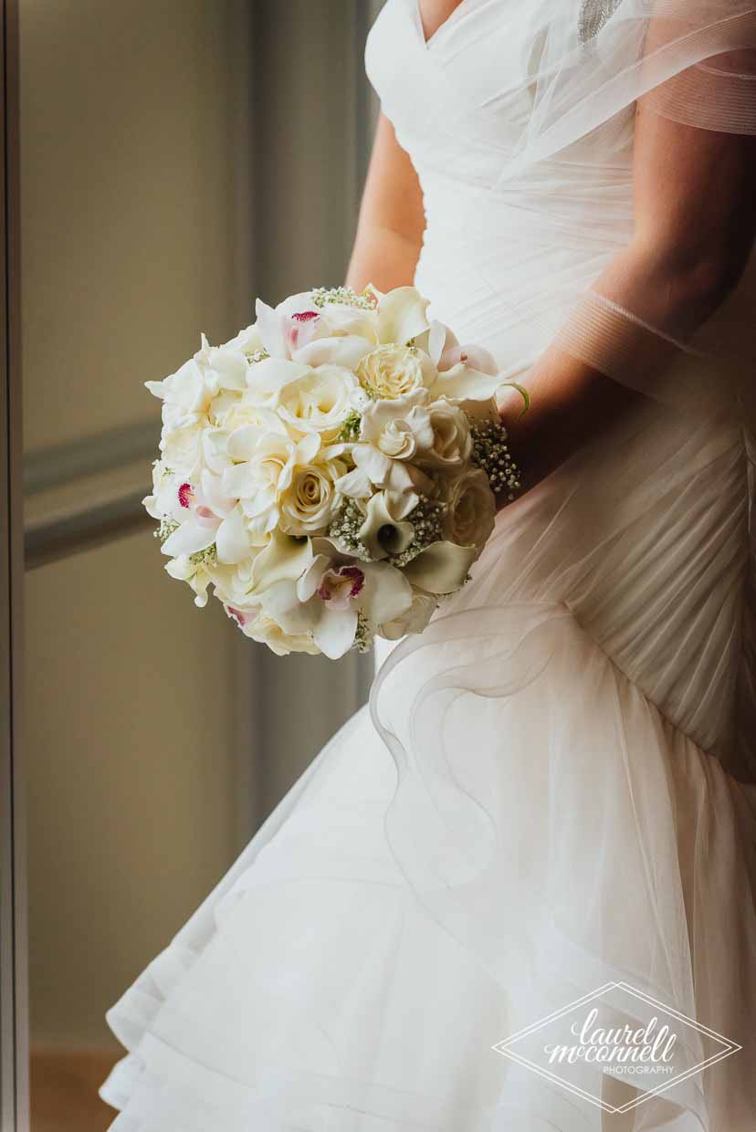 Tight and dense bridal bouquet of white roses, spray roses, garden roses - by Flora Nova Design Seattle