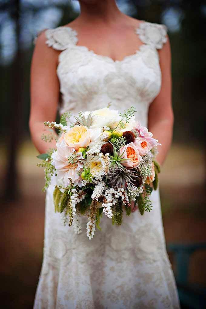 Romantic, textured bridal bouquet of peach Juliet garden roses, roses, grasses, amaranthus, designed by Flora Nova Design Seattle