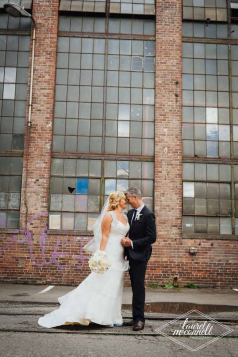 Flora Nova Design Seattle Luxury White Wedding Sodo Park Bride and Groom