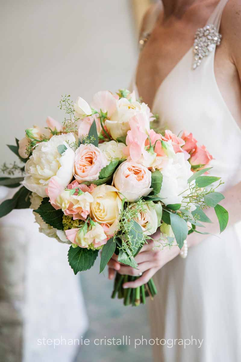 Dense bridal bouquet of blush garden roses, white peonies, blush spray roses, and light pink roses, with accents of greenery - Bridal Bouquet Cost by Flora Nova Design Seattle