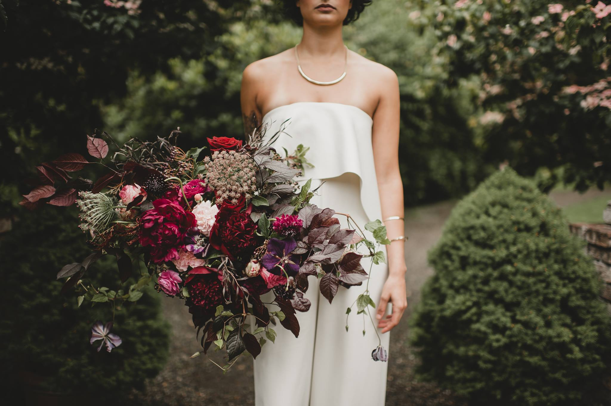 Freeform bridal bouquet of nigella and agonis foliage, burgundy peonies, Queen Anne's lace, clematis vines, garden roses, and scabiosa - bridal Bouquet Shapes by Flora Nova Design Seattle