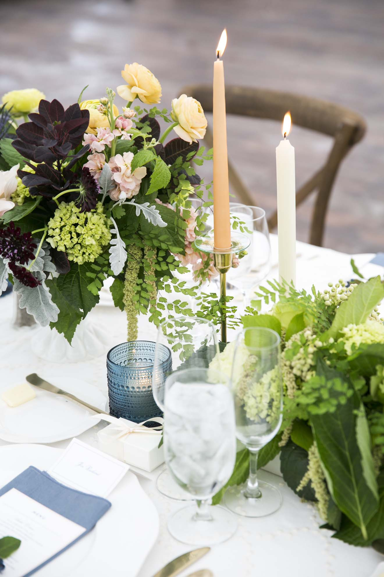 Centerpieces with green roses, mini green hydrangea, amaranthus, with peach taper candles, and French blue votive candle