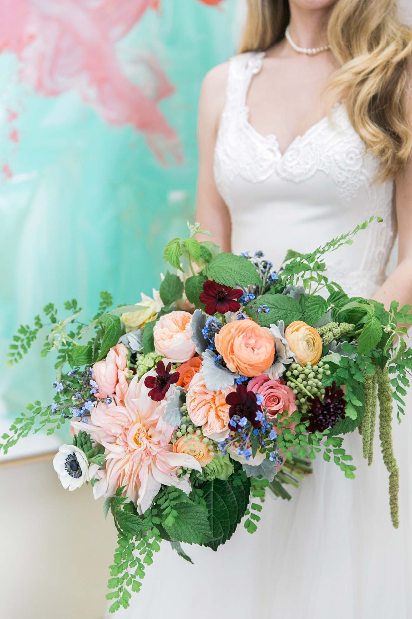 Bridal bouquet of orange roses, Juliet garden roses, cafe au lait dahlias, chocolate cosmos, anemones, raspberry foliage, green amaranthus, Maidenhair fern - designed by Flora Nova Design for a Pacific Northwest Wedding