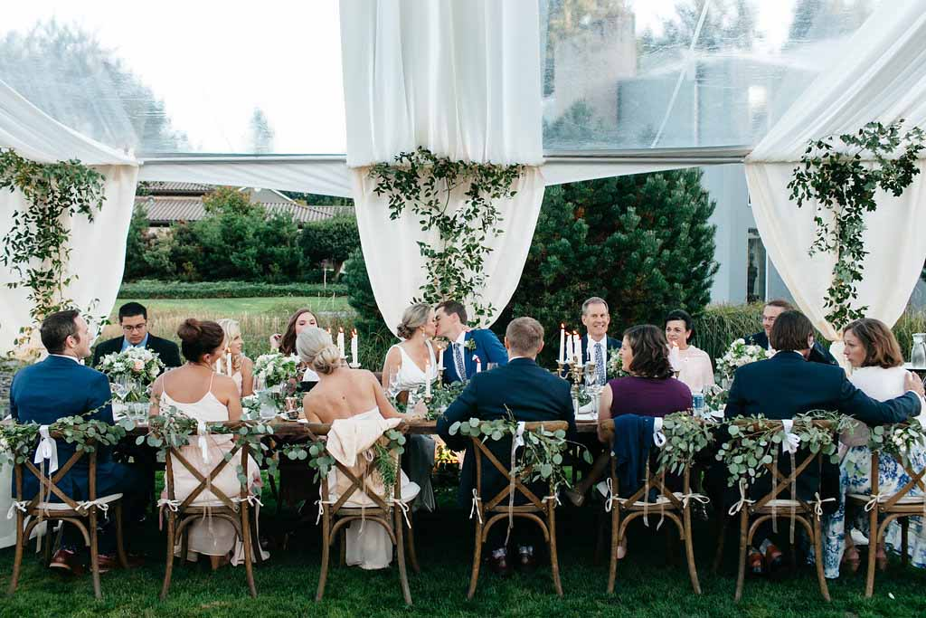 Long wooden head table at a Seattle garden wedding - Flora Nova Design seattle