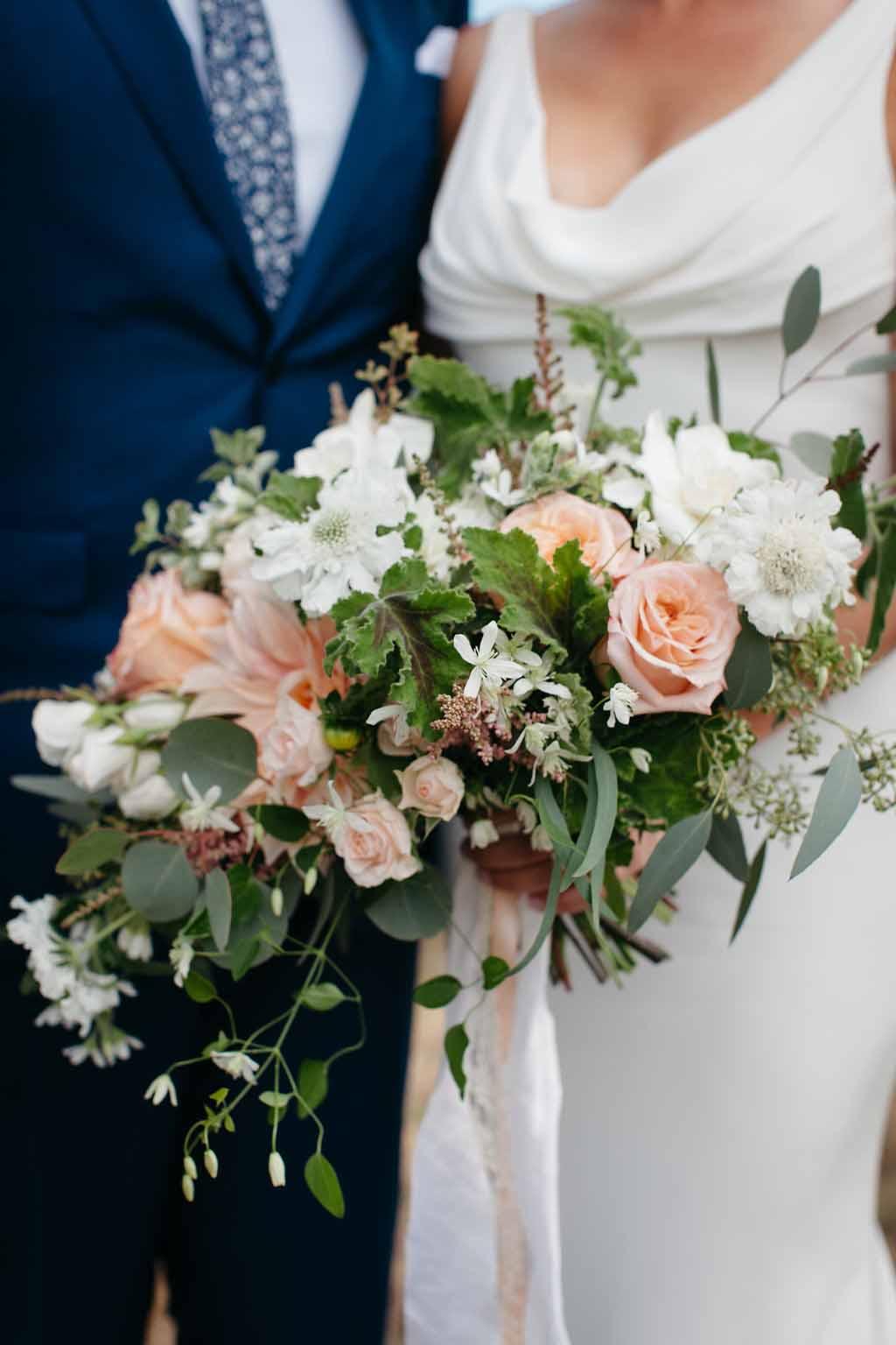 Bridal bouquet featuring peach roses, cream spray roses, trailing greenery - Elegant Seattle Garden Wedding by Flora Nova Design Seattle