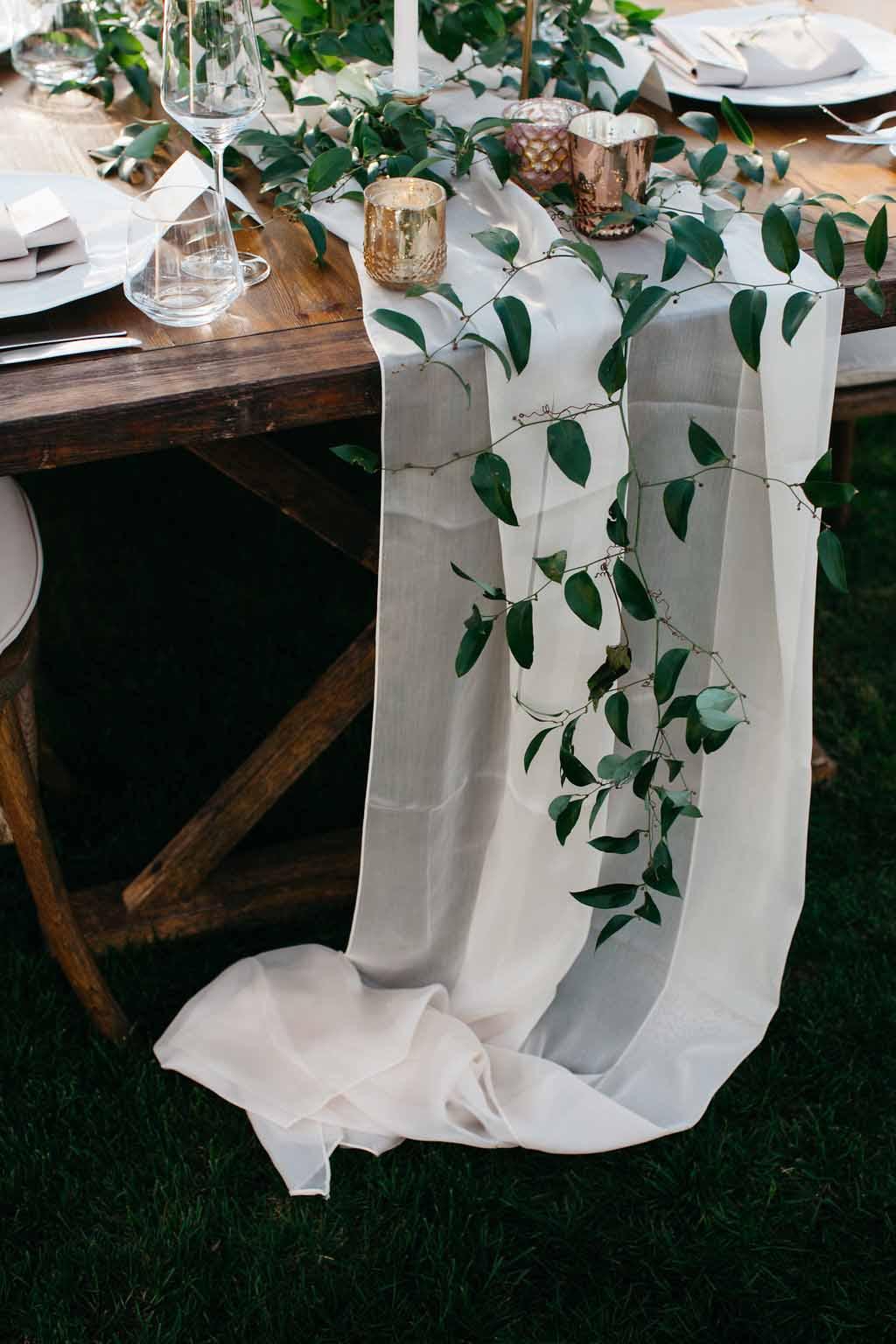 Greenery trailing down draped wooden table - Elegant Seattle Garden Wedding by Flora Nova Design Seattle