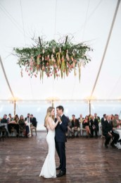 Large floral chandelier in Wedding Reception tent