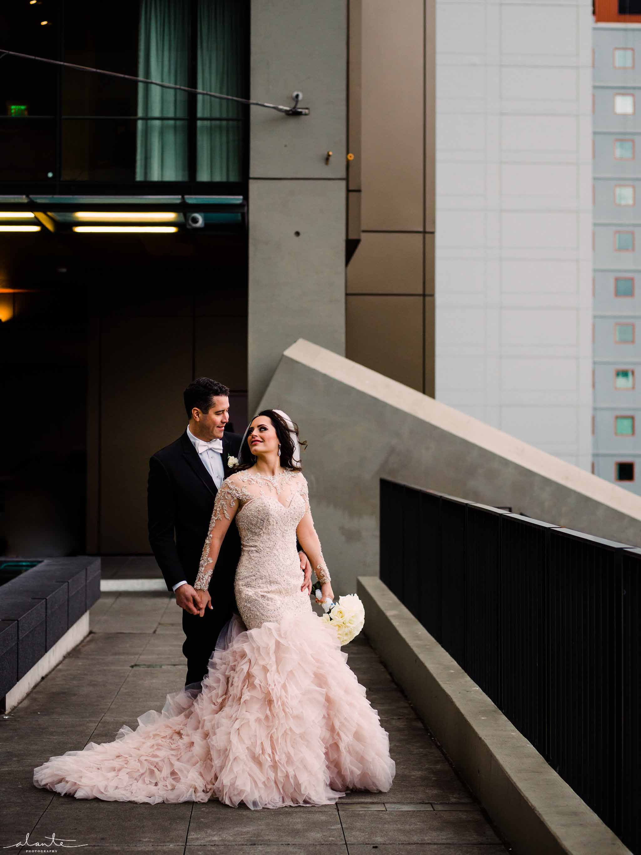 Bride and groom at the winter wedding at Four Seasons Seattle - Luxury Winter Wedding at the Four Seasons by Flora Nova Design Seattle
