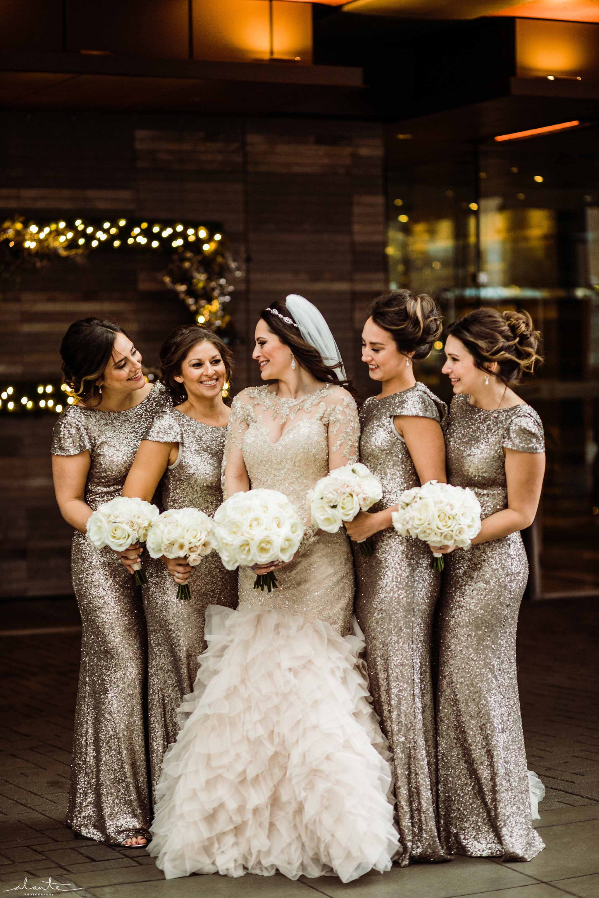 Bride and brides maids with bouquets of all white roses - Luxury Winter Wedding at the Four Seasons by Flora Nova Design Seattle