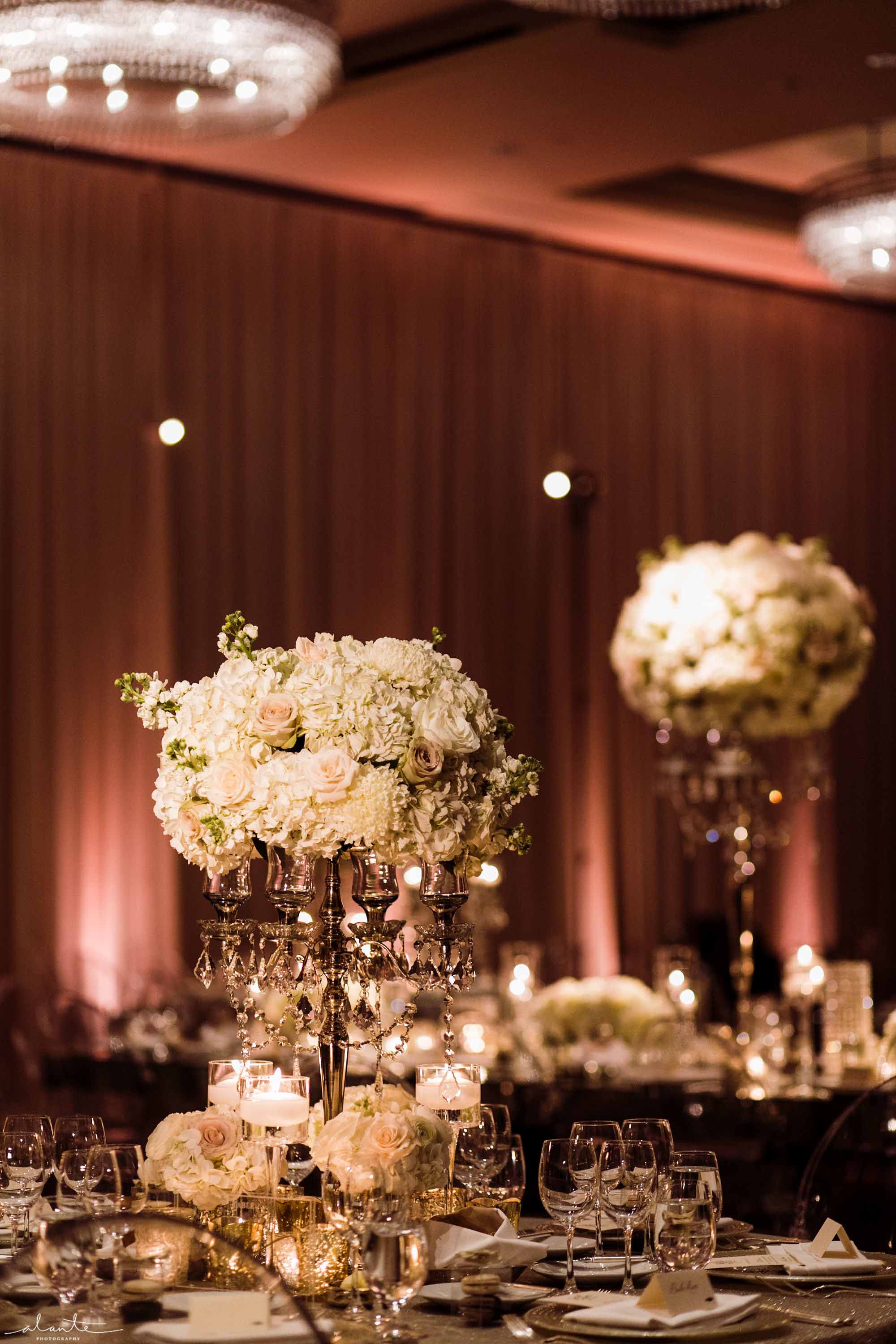 Elevated centerpieces with white flowers propped onto silver crystal candelabra - Luxury Winter Wedding at the Four Seasons by Flora Nova Design Seattle