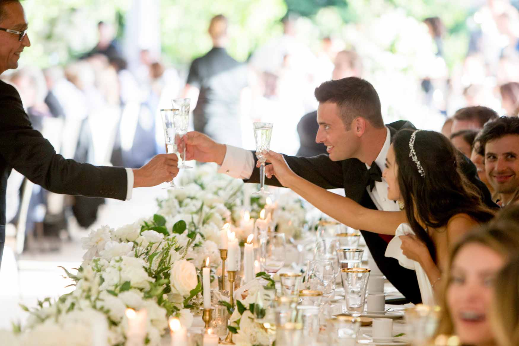 A toast to the wedding couple, flower lined head table - Elegant Summer Private Estate Wedding. Flora Nova Design Seattle