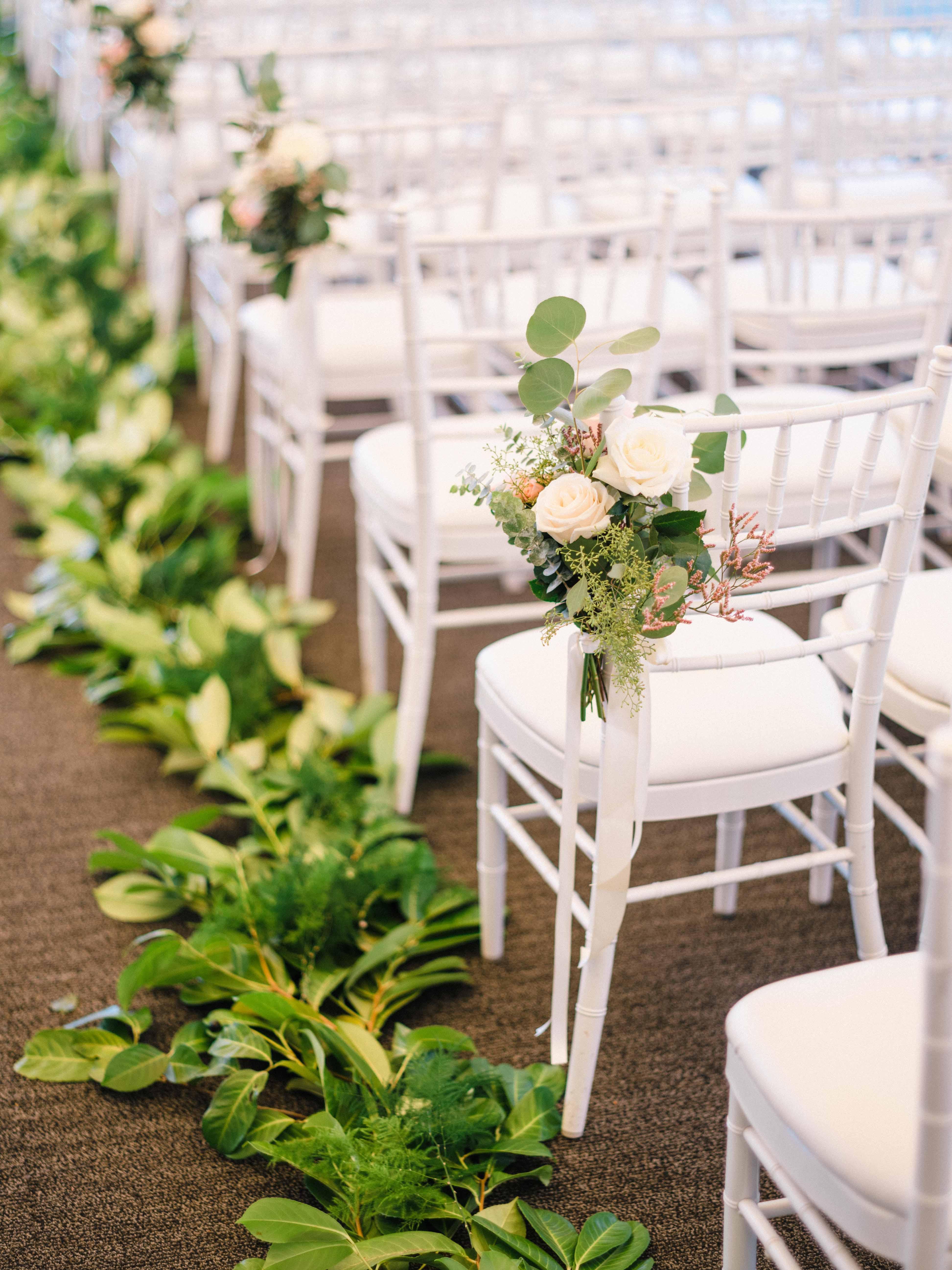 Greenery garlands lining a wedding ceremony aisle - Woodmark Hotel Wedding by Flora Nova Design Seattle