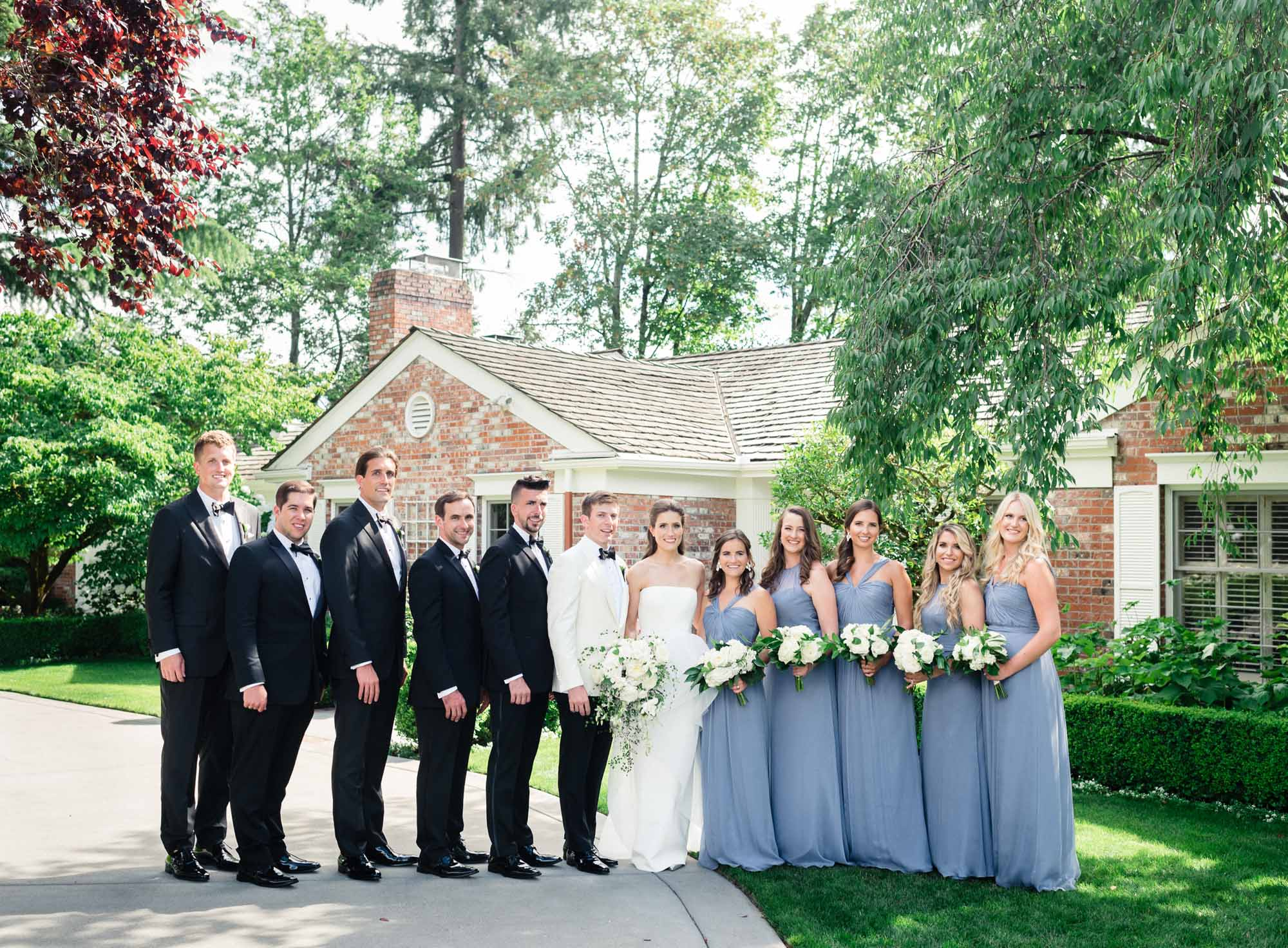 Wedding party with white and green wedding flower bouquets