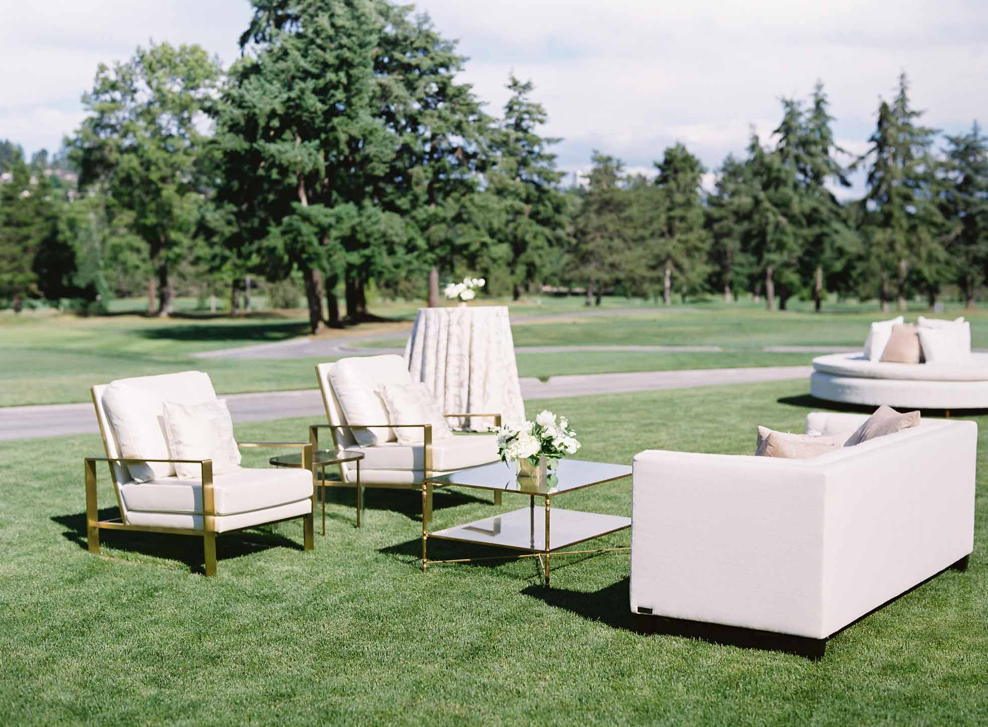 White lounge furniture for a wedding cocktail hour at Overlake Country Club - by Flora Nova Design