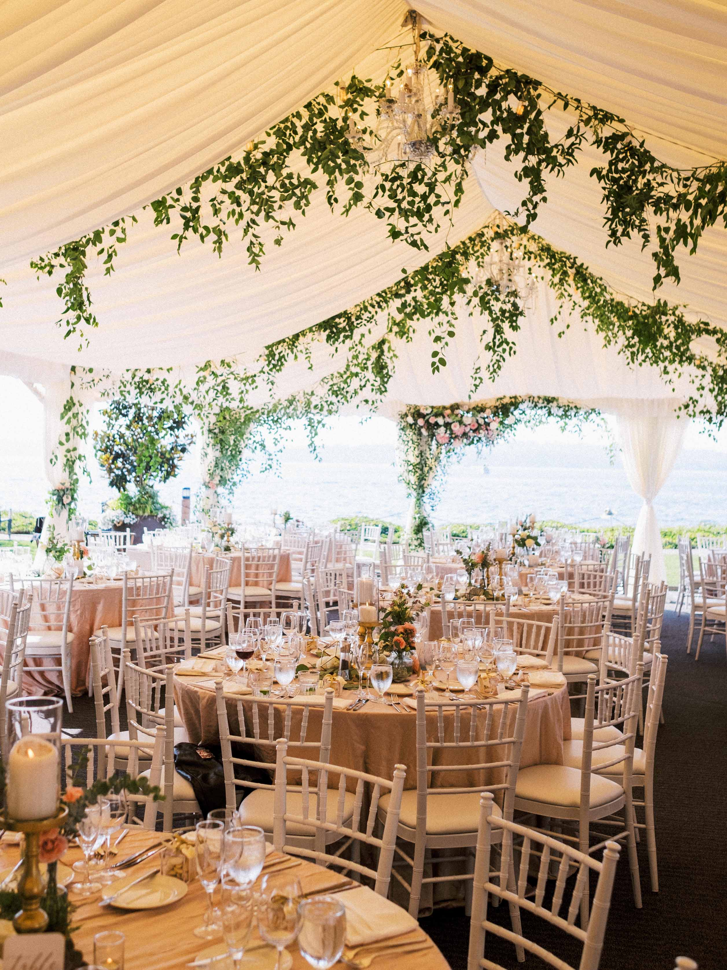 Wedding reception at the Woodmark Hotel with ceiling greenery, designed by Flora Nova Design Seattle