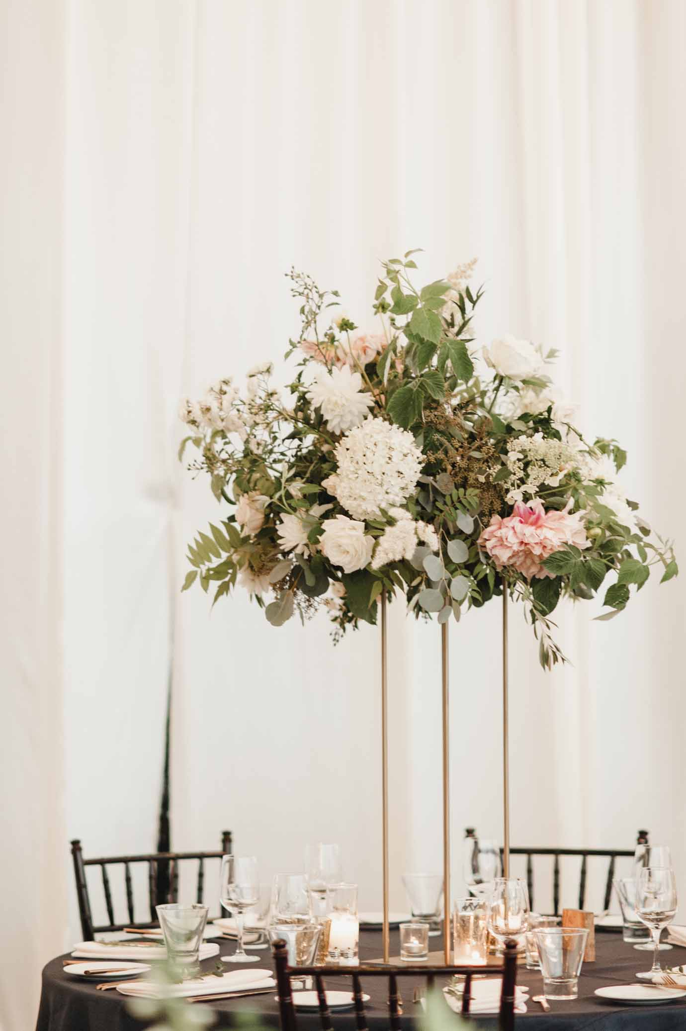 Elevated centerpiece with greenery on gold Harlow stand - Flora Nova Design