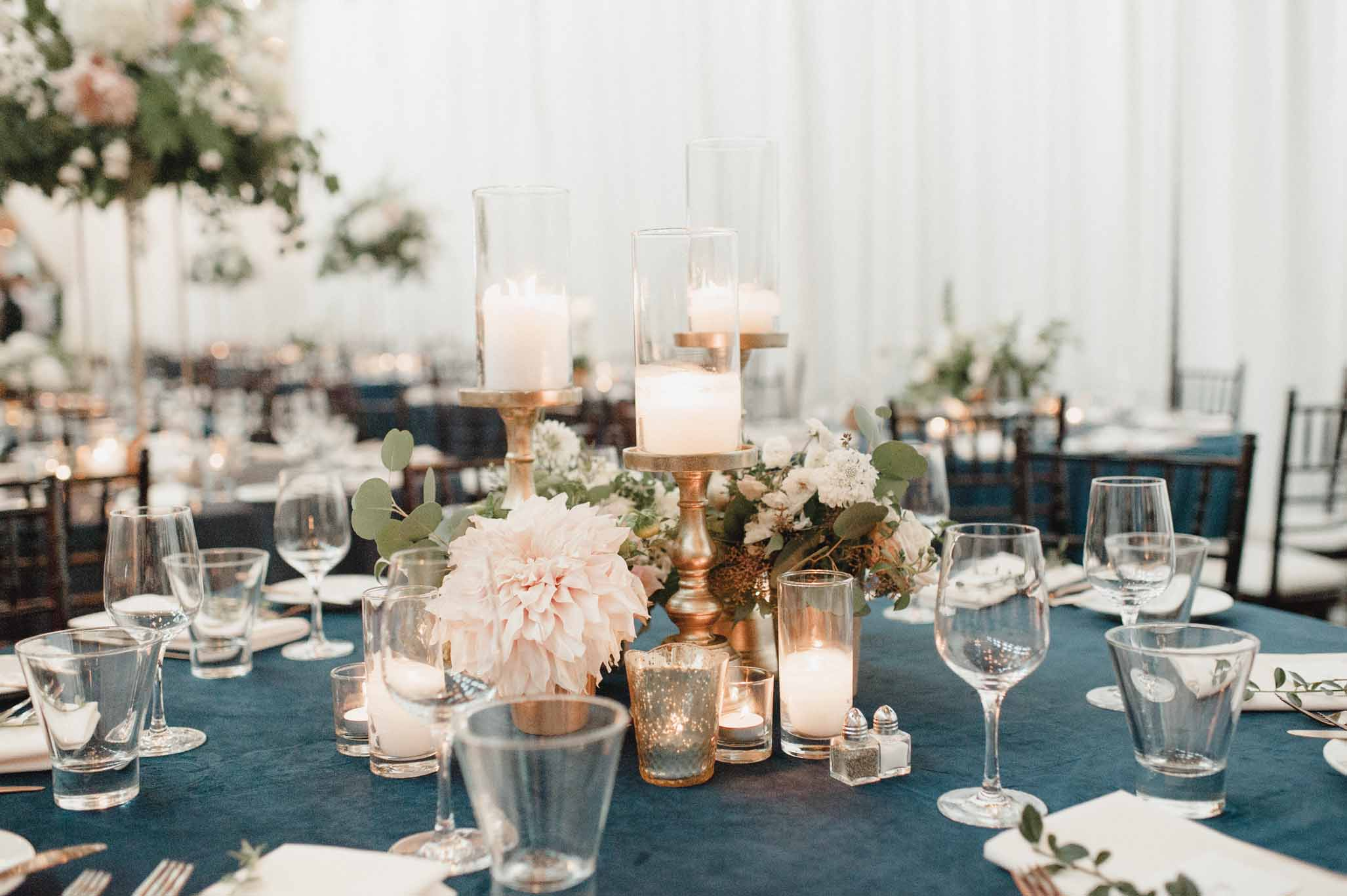 Composite style centerpiece with candles and flowers on blue linen - Greenery SoDo Park Wedding Flora Nova Design Seattle