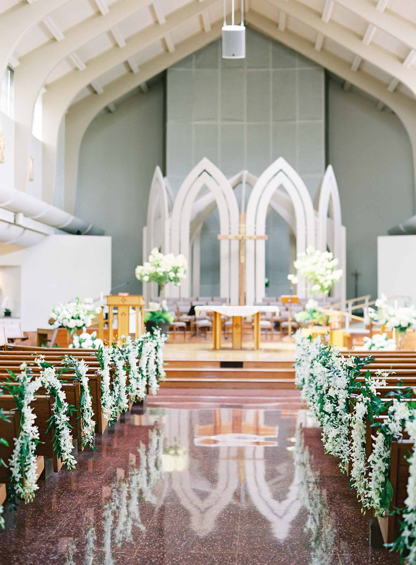 Wedding church aisle decorated with greenery and white orchids - Flora Nova Design