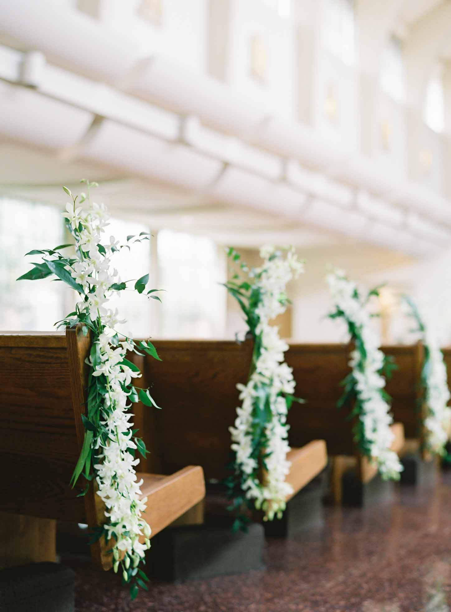 Wedding church pews decorated with white dendrobium orchids - White and Green Wedding - Flora Nova Design
