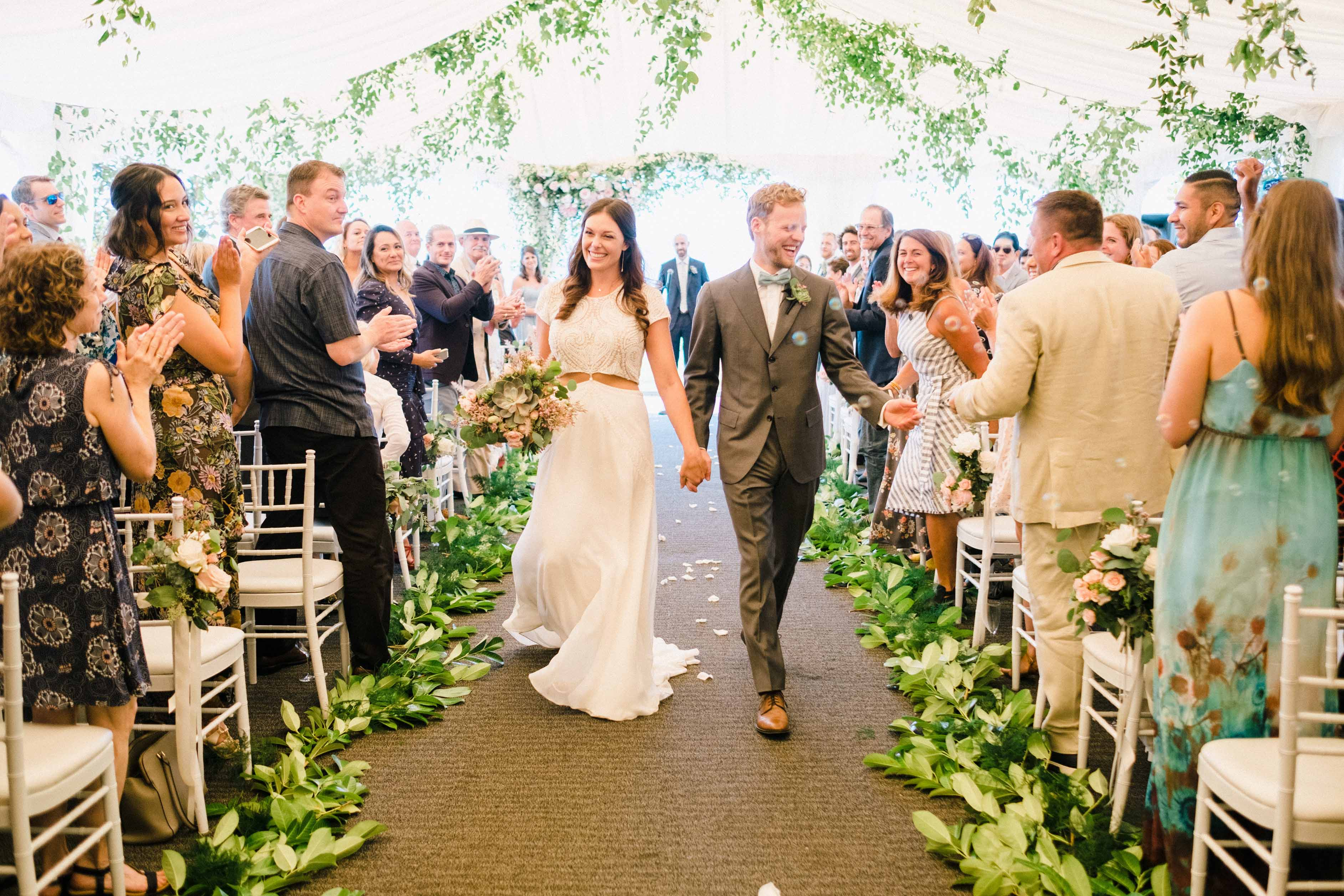 Couple just married walking down the aisle at their Woodmark Hotel wedding, Flora Nova Design Seattle