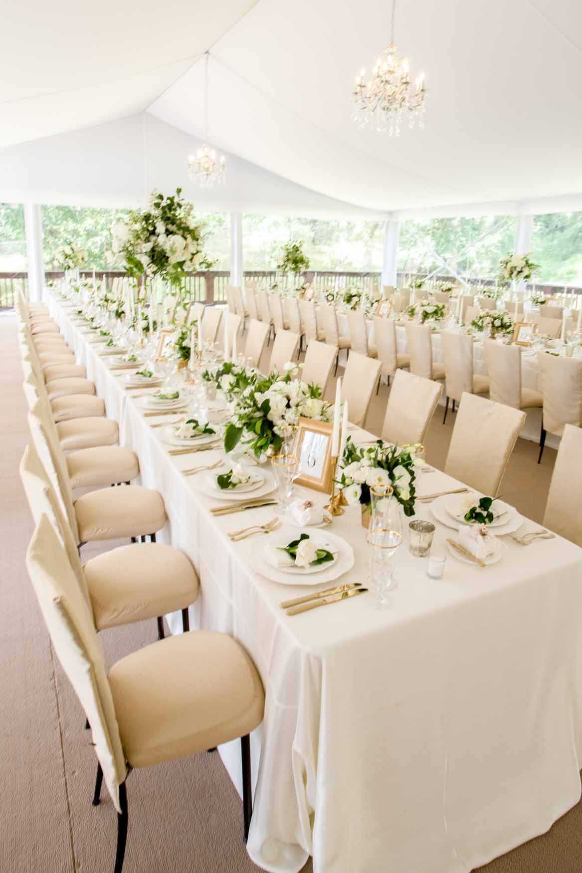 Long tables lined with white centerpieces - Elegant Summer Private Estate Wedding. Flora Nova Design Seattle