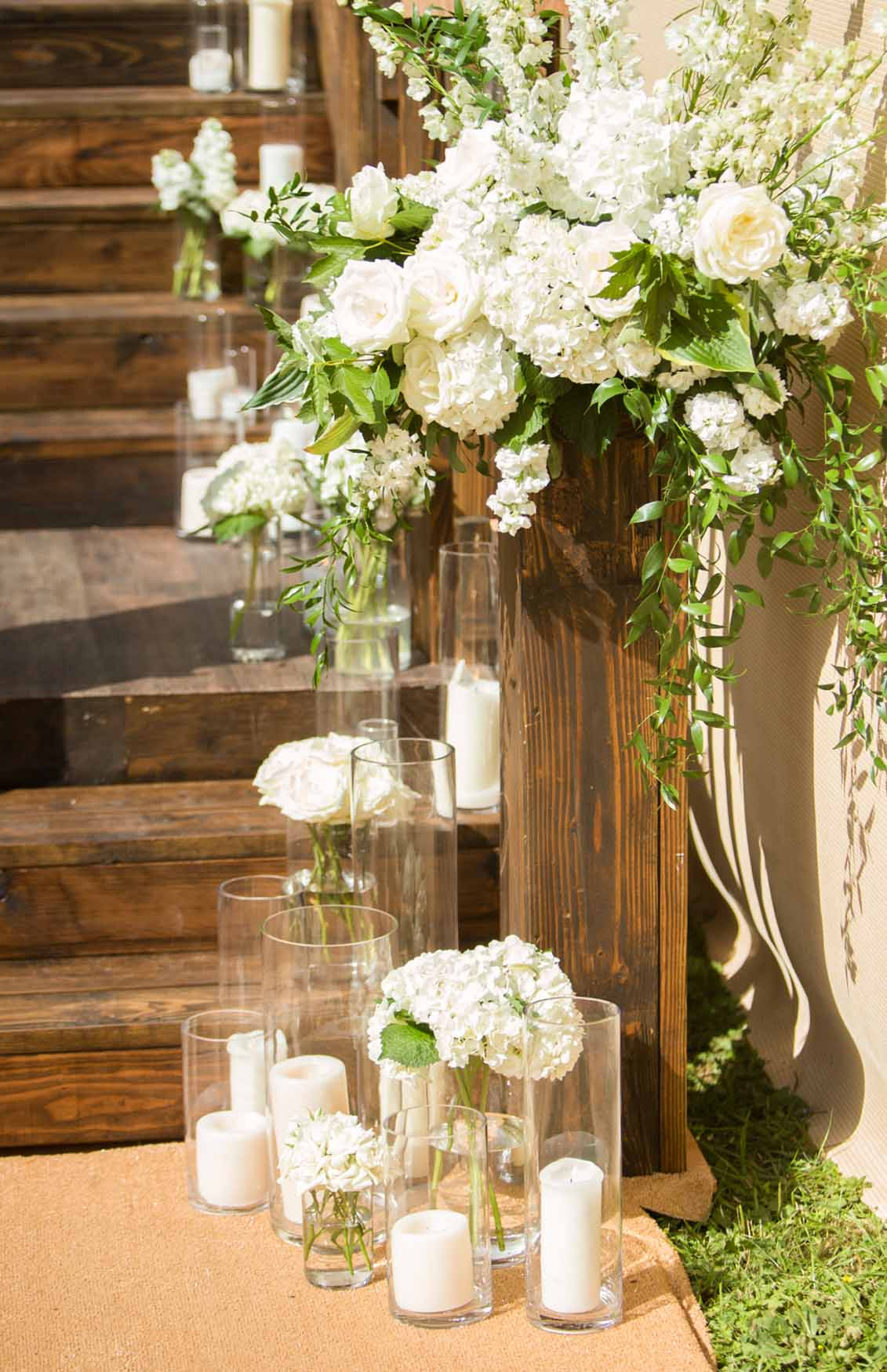 A flower lined stairway into the wedding tent- Elegant Summer Private Estate Wedding. Flora Nova Design Seattle
