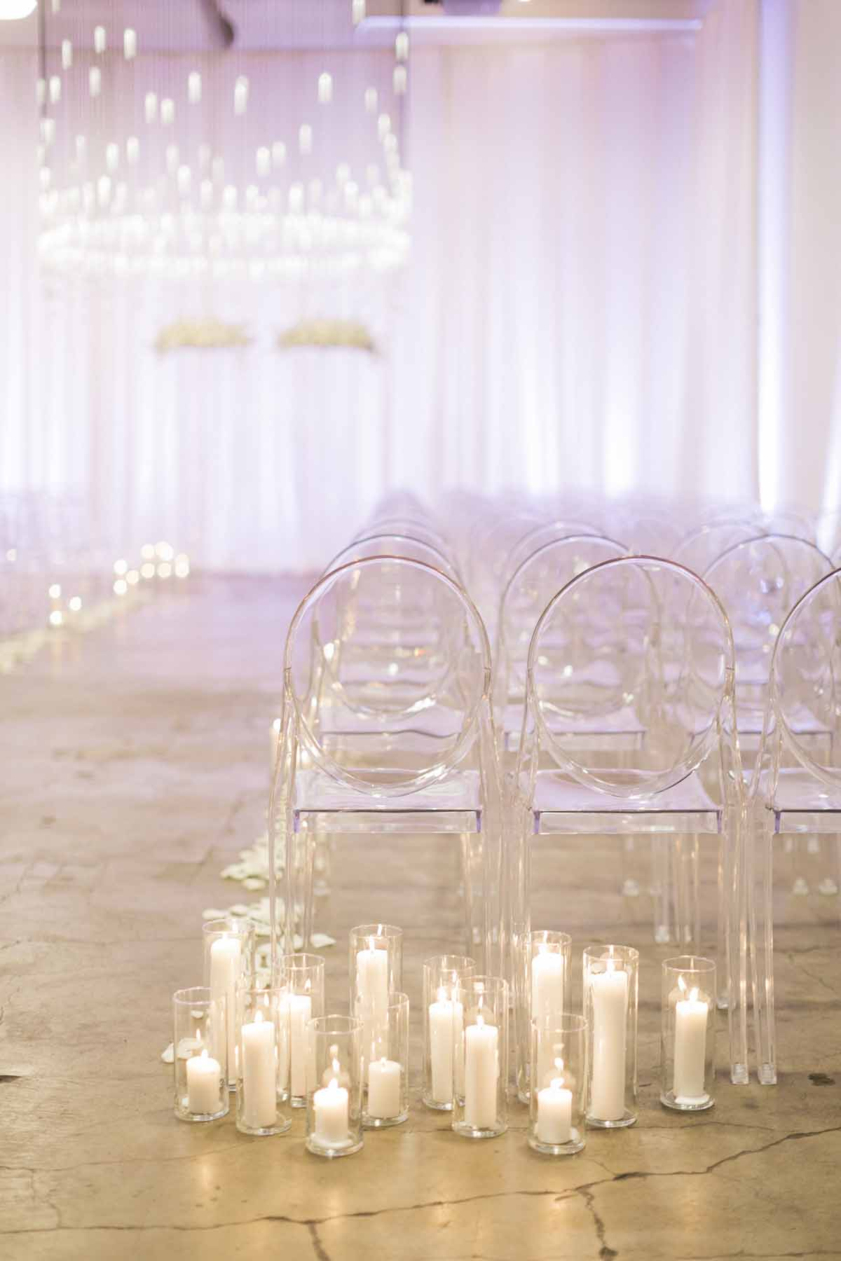 Modern white wedding ceremony with lots of candles at Canvas Event Space