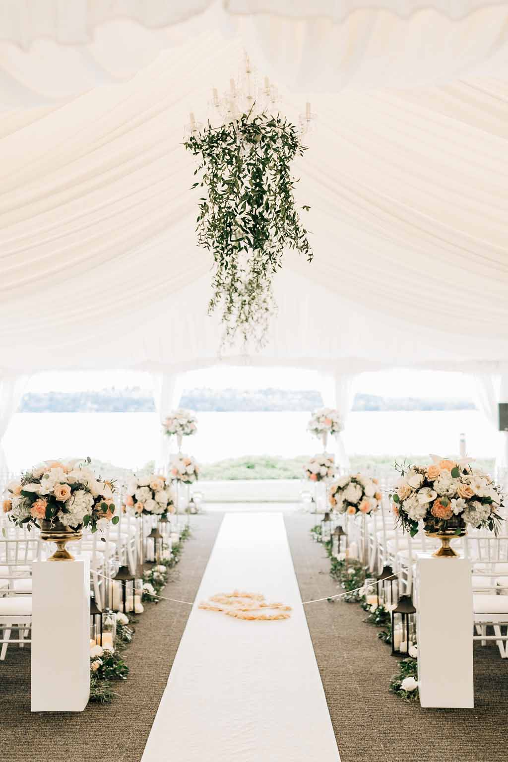 Wedding aisle lined with flowers and greenery chandelier for Lake Washington Wedding - by Flora Nova Design