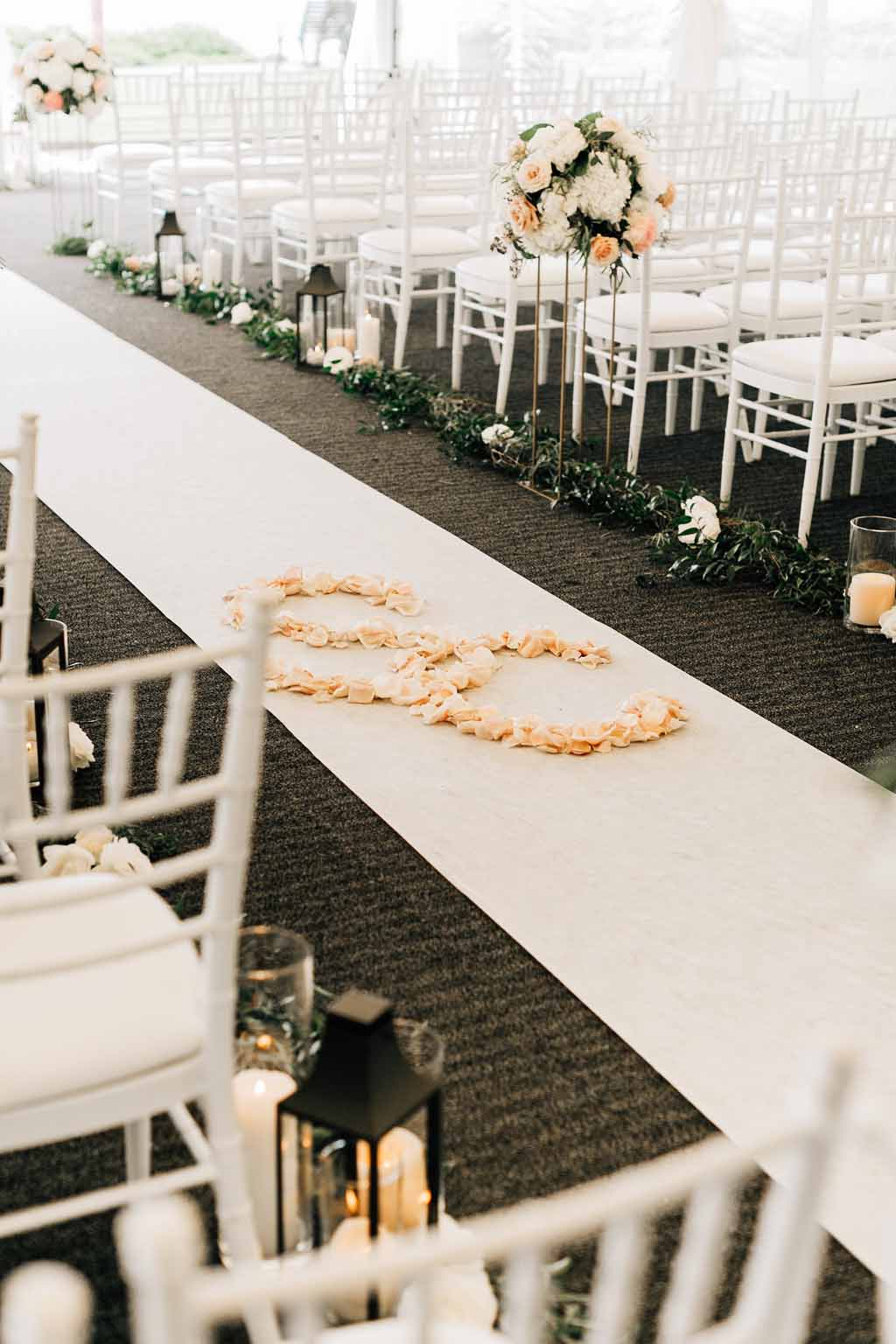 Initials out of rose petals on white aisle runner for Lake Washington Wedding