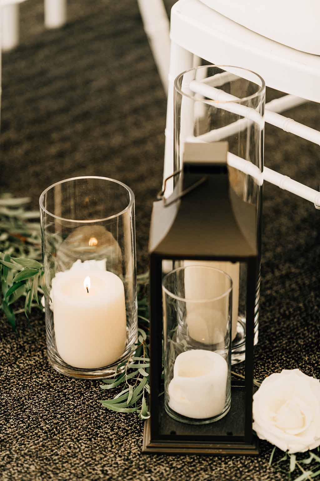 Hurrican candles and lanterns as wedding aisle decor