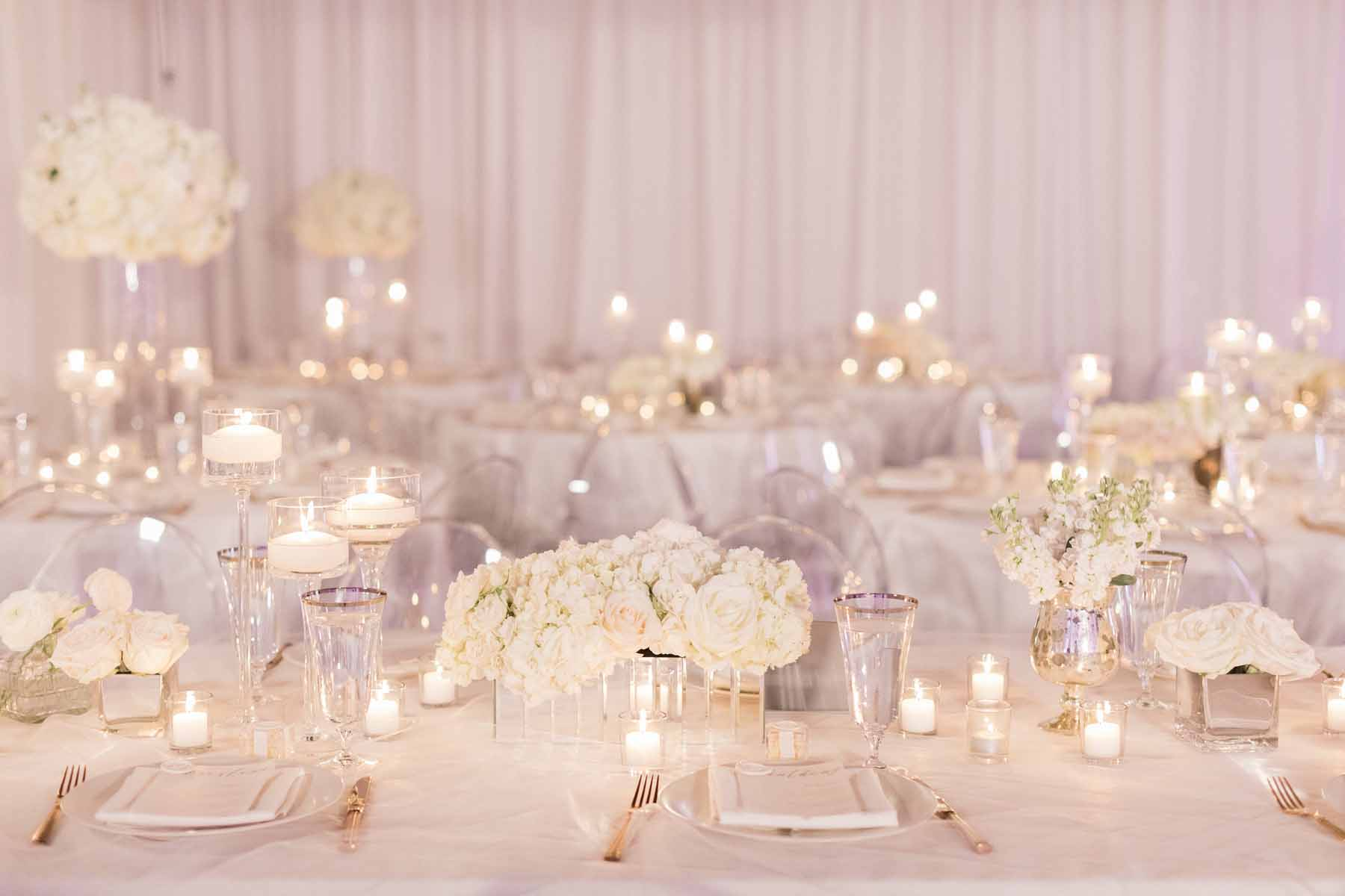 Modern in all white at Canvas Event Space wedding: white draping, white linens, white centerpieces