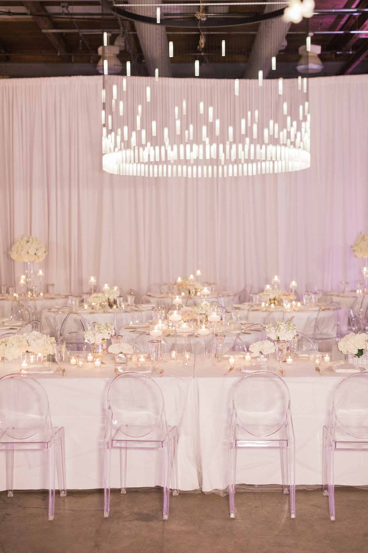 Grand chandelier at all white reception at Canvas Event Space wedding