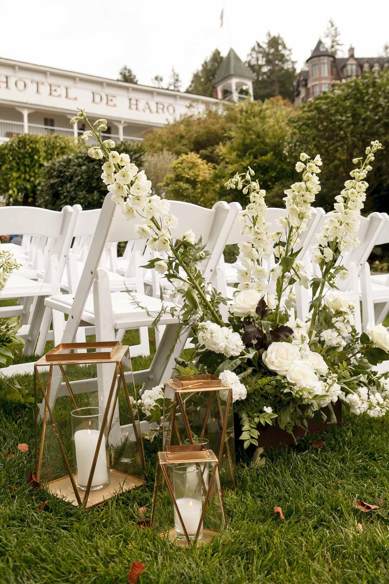 Wedding ceremony decor with lanterns and white flowers