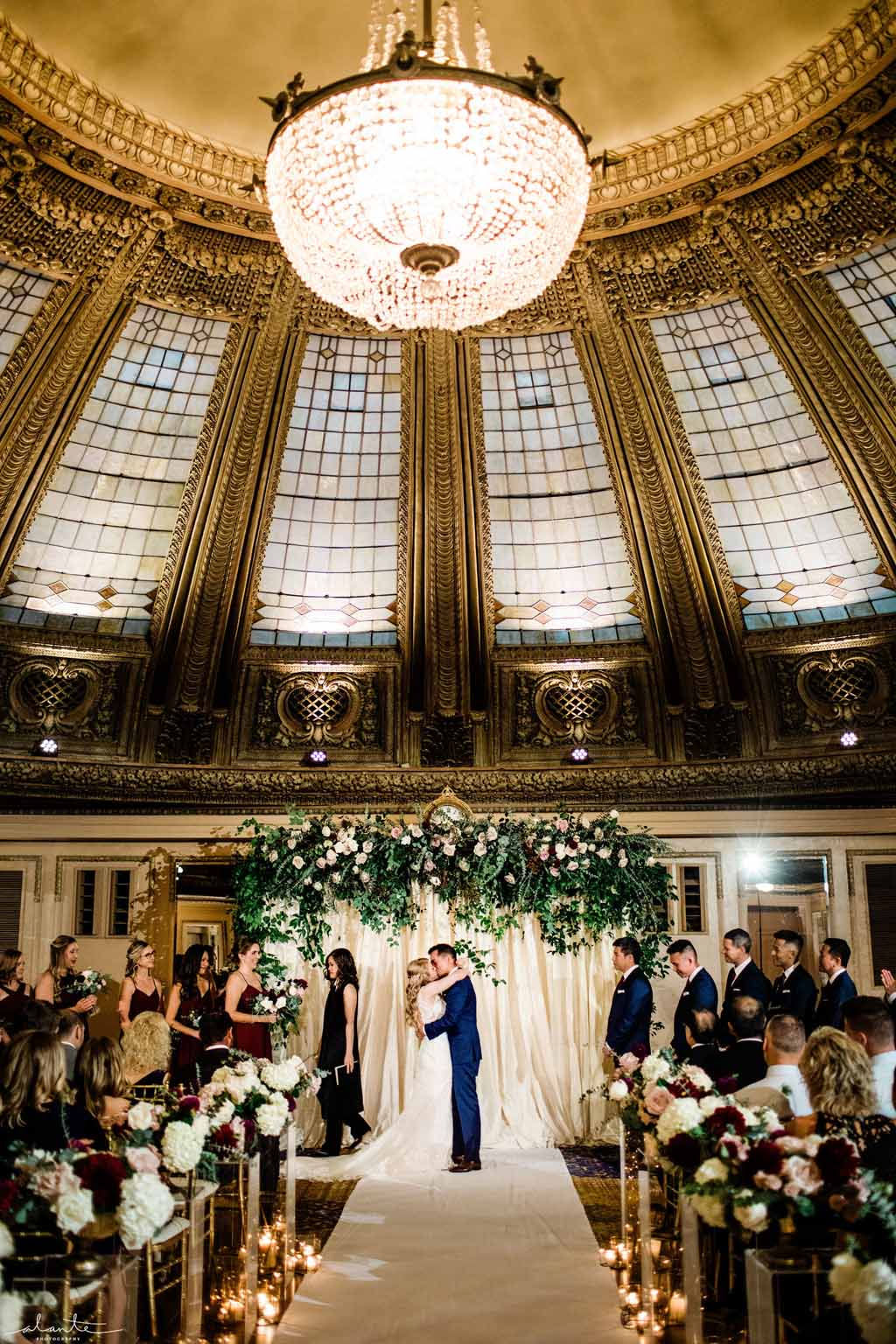 Wedding kiss under the domed ceiling at the Arctic Club Seattle