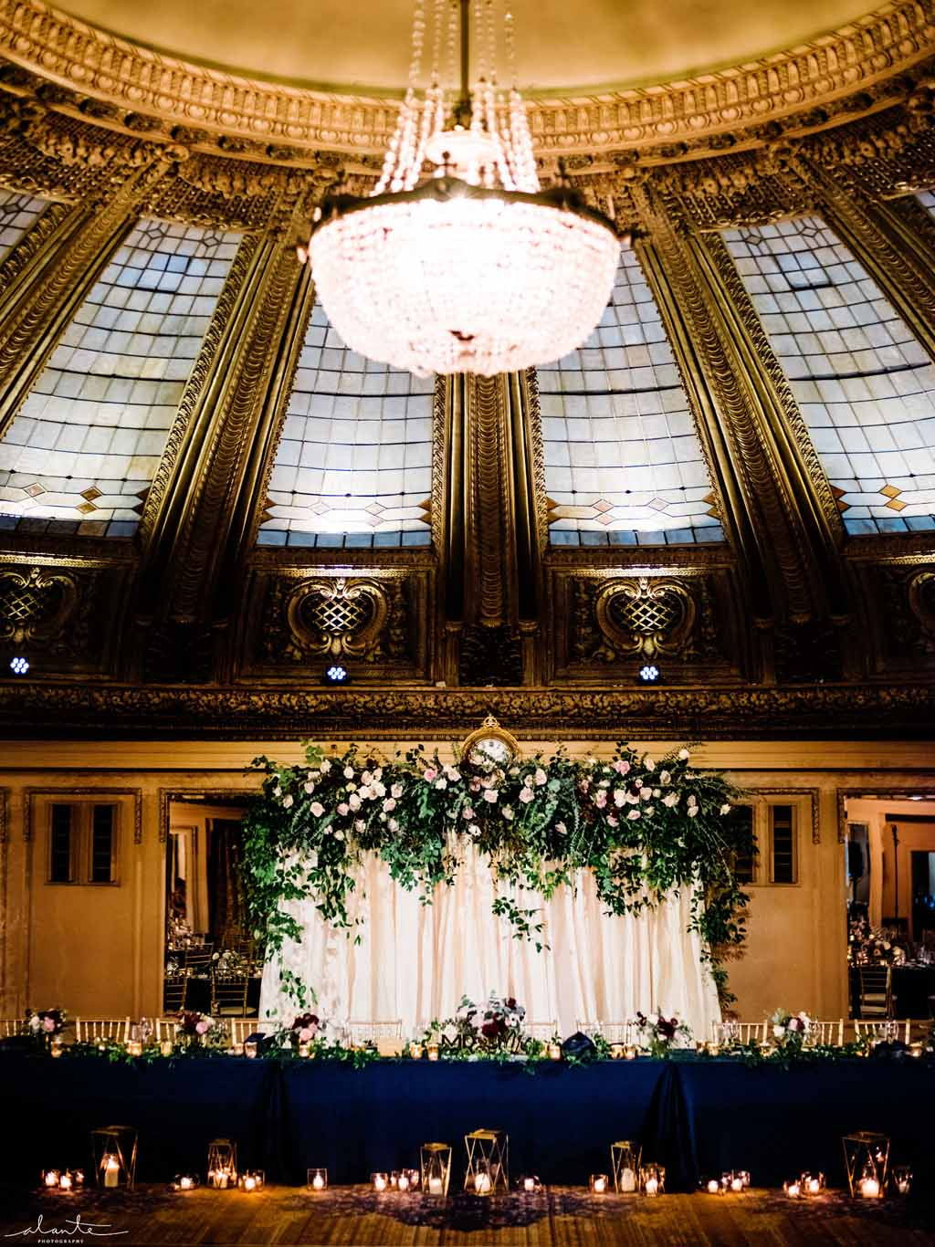 Greenery arch behind the head table