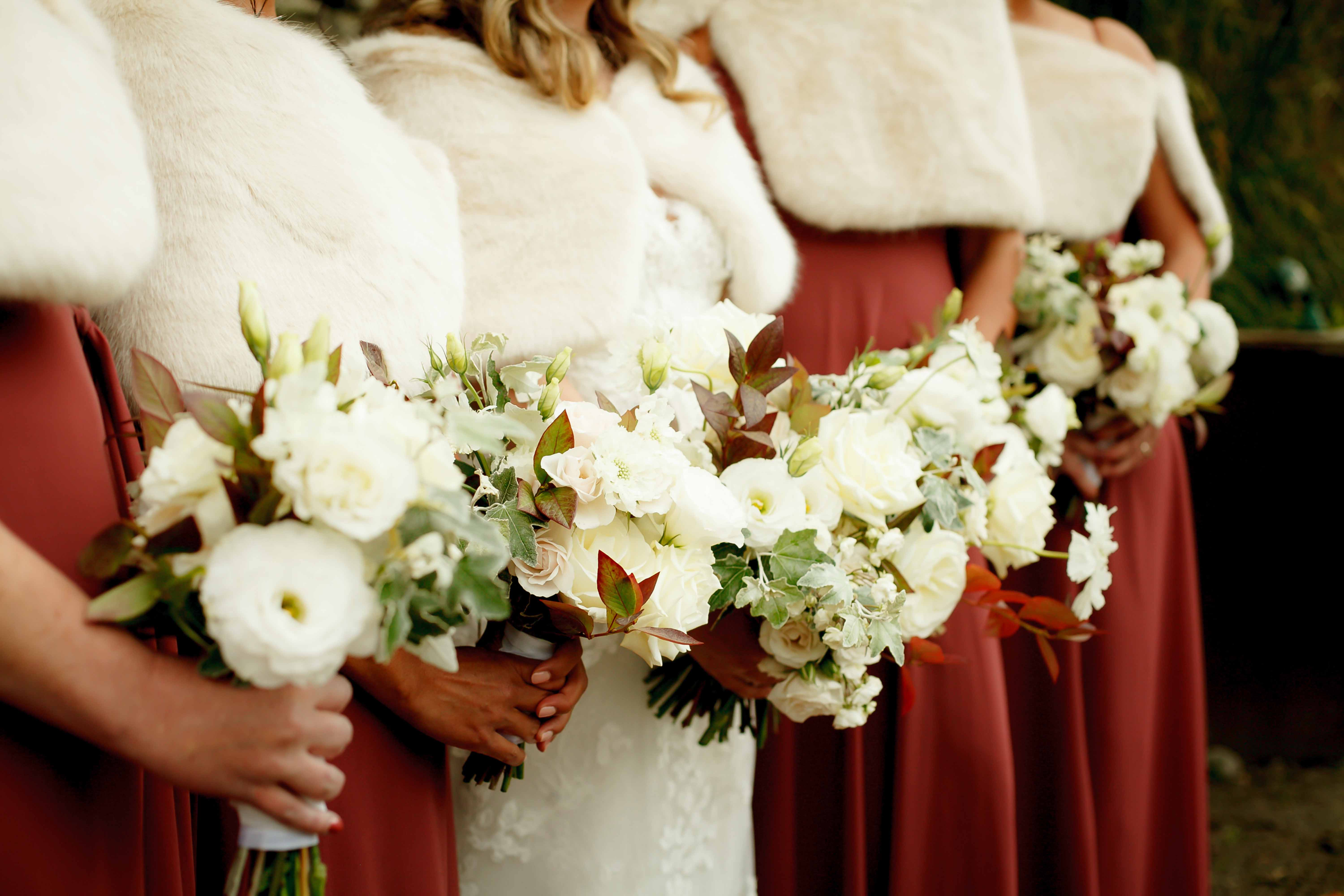 Bride's maids wedding bouquets in fall textures