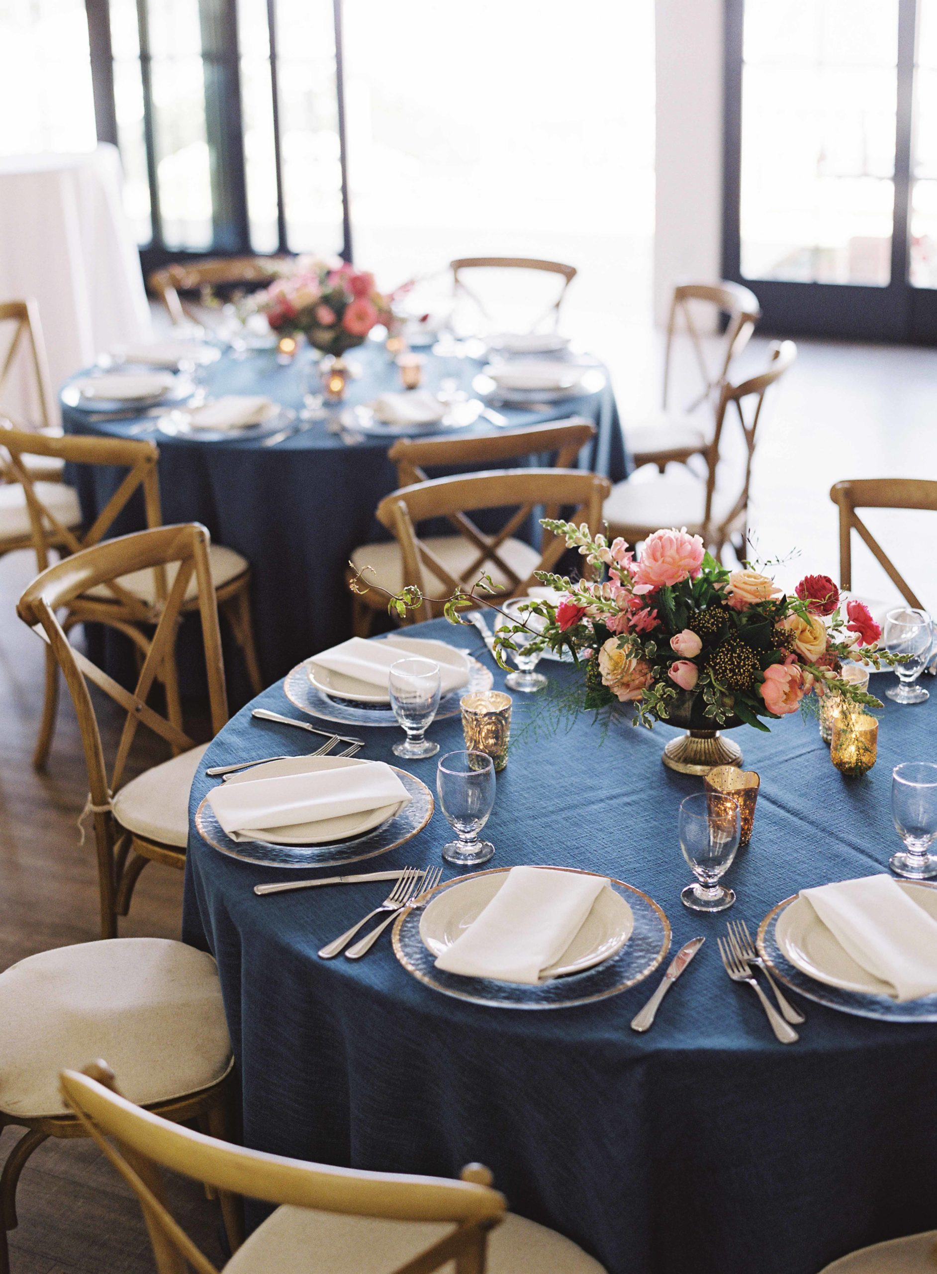 Wedding reception in blue, hot pink, and peach with wooden vineyard chairs and gold accents - Seattle Wedding Flowers by Flora Nova Design; Hot pink and peach wedding at Roche Harbor Resort