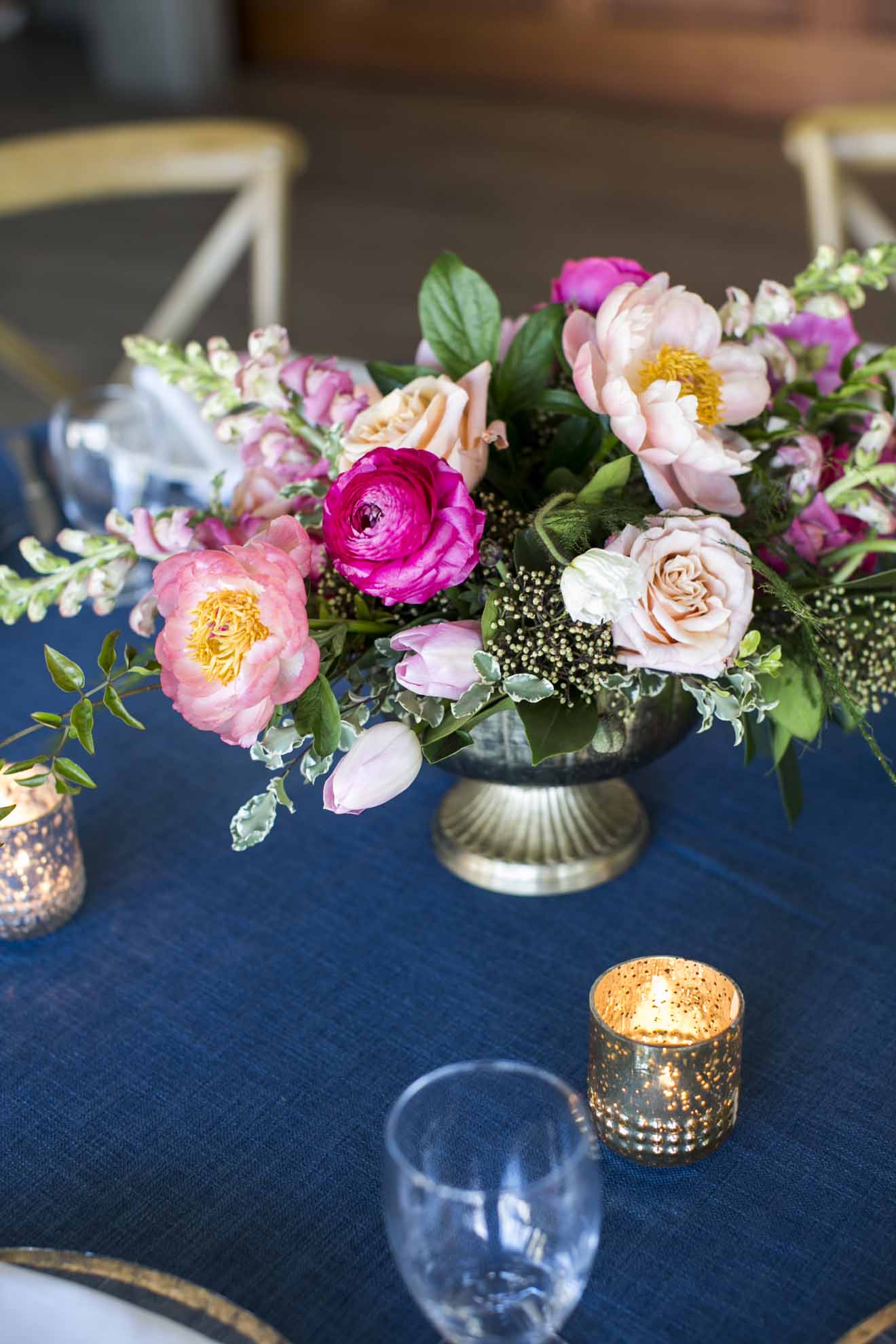 Hot pink and peach wedding centerpiece on dark blue linen with gold compote and gold votive candle - Seattle Wedding Flowers by Flora Nova Design; Hot pink and peach wedding at Roche Harbor Resort