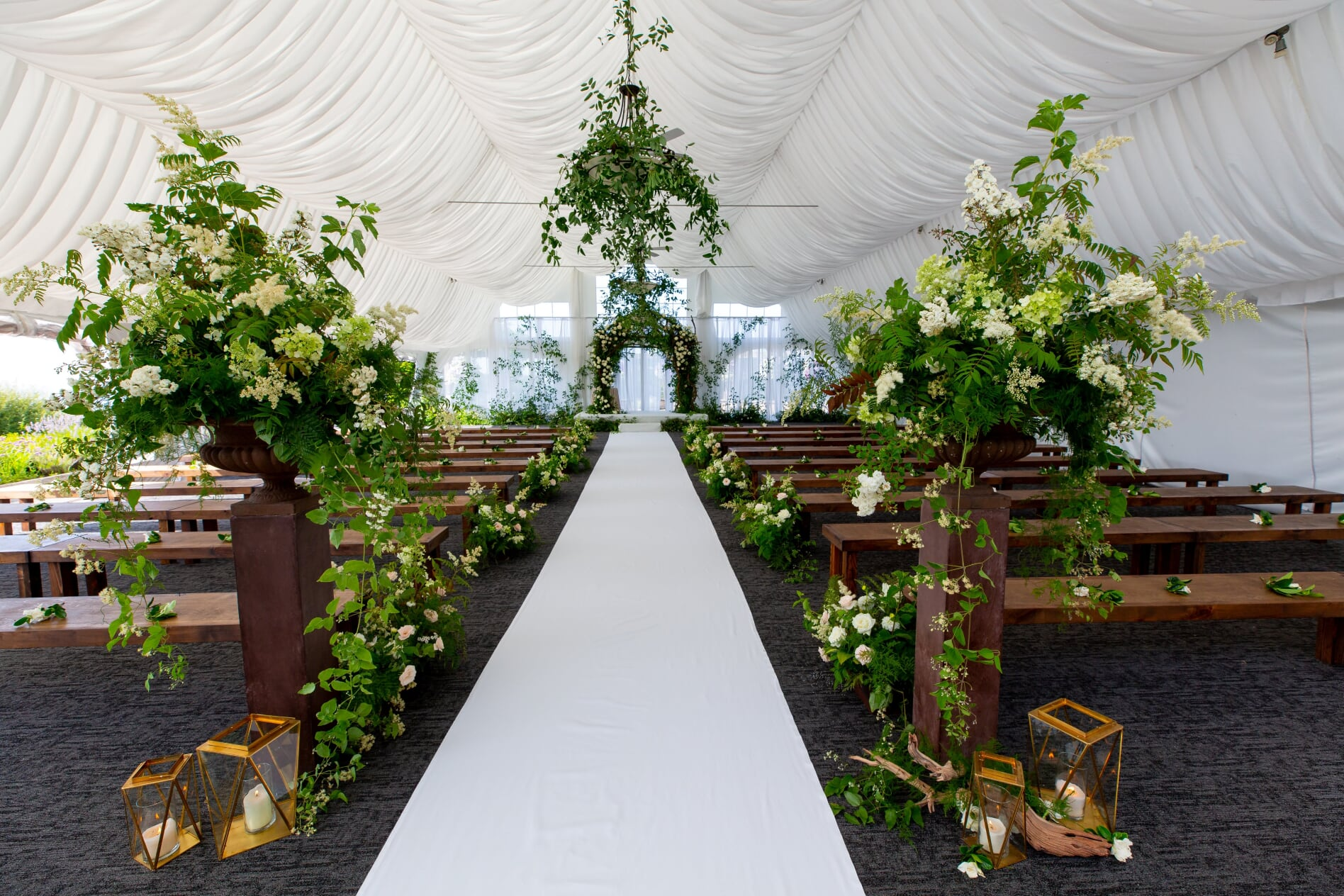 Midsummer Night's Dream Wedding ceremony aisle lined with greenery