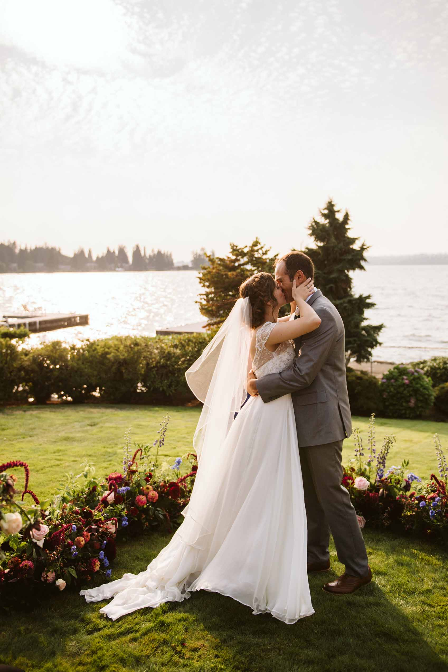 First kiss at intimate summer wedding ceremony in backyard | Flora Nova Design