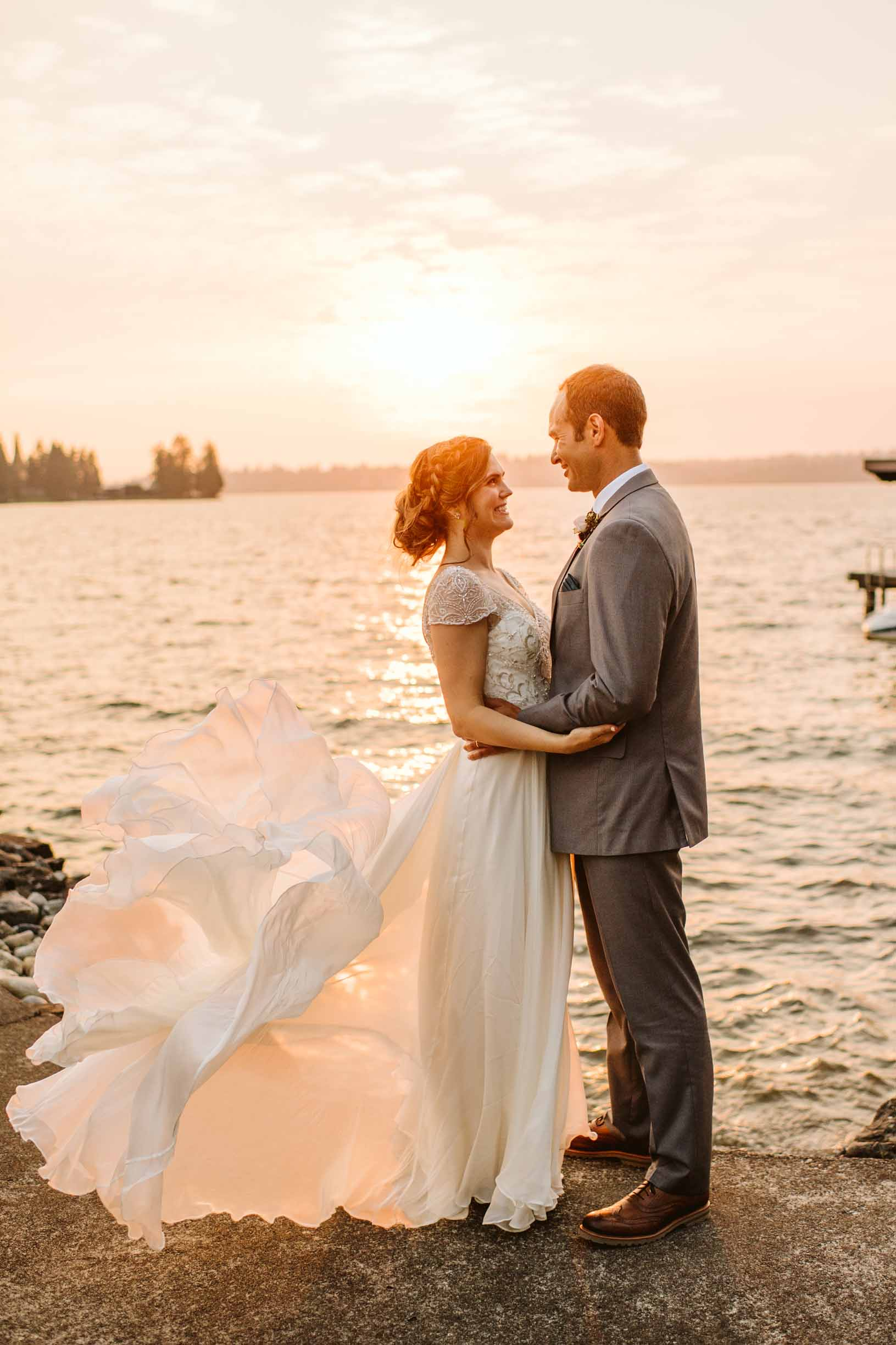 Bride and groom on their wedding day on Lake Washington at sunset.