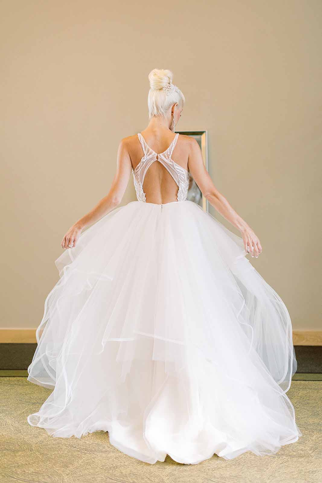Formal wedding photo with back of the wedding dress detail, large white ballgown style dress