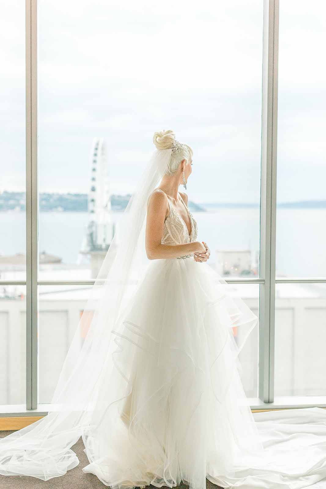 Formal white orchid wedding bride in the ballroom of Four Seasons Seattle
