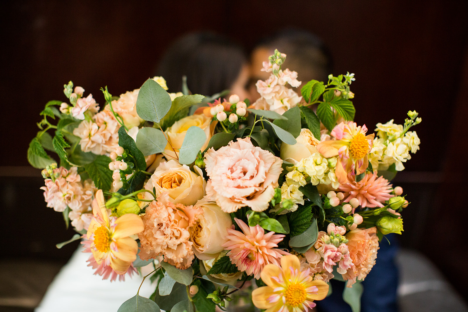Coral, peach and grey bridal bouquet featuring local dahlias for an Autumn Wedding at Chihuly Gardens and Glass | Flora Nova Design