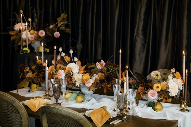 Decorating for the Holidays: Thanksgiving table with fresh flower centerpieces, decked with taper candles, mustard yellow napkins, wooden table, Provence chairs - FLORA NOVA DESIGN SEATTLE