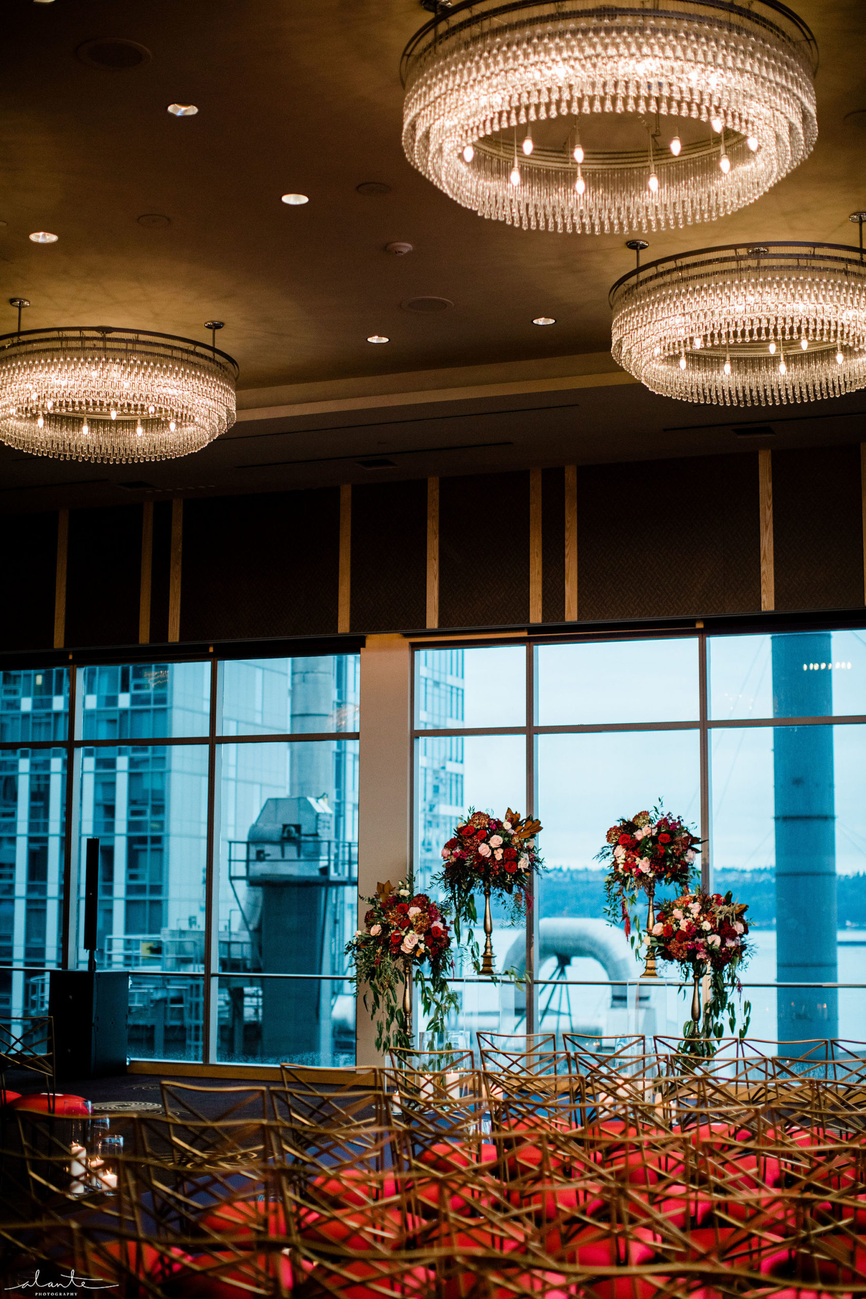 Four Seasons Seattle ballroom wedding ceremony set up with tall floral pieces at the front of the aisle.